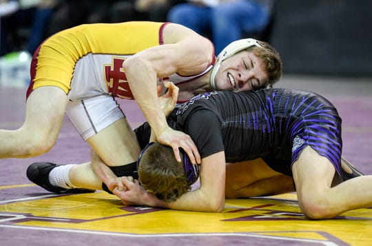 Alec Freeman of Mater Dei decisioned Logan Miller of Brownsburg 3-2 in the semistate championship match of the 106-pound weight class Saturday at the Ford Center.