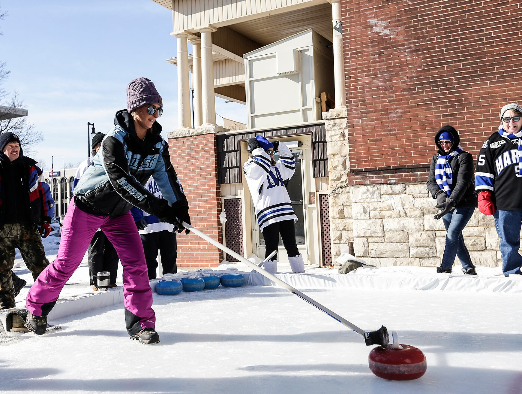 Dani Meyer of Plymouth pushes a curling stone Saturday, February 9, 2019 in downtown Fond du Lac during Sturgeon Spectacular. Sturgeon Spectacular is a weeklong celebration of the lake sturgeon spearing season and includes events on and off the ice in the Fond du Lac area. Doug Raflik/USA TODAY NETWORK-Wisconsin