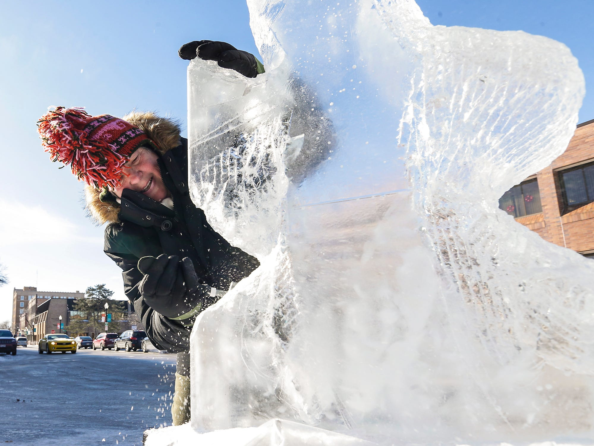 Jean Koerner of Montello works on an ice sculpture of what will be an eagle Saturday, February 9, 2019 on Main Street in downton Fond du Lac during Sturgeon Spectacular. Sturgeon Spectacular is a weeklong celebration of the lake sturgeon spearing season and includes events on and off the ice in the Fond du Lac area. Doug Raflik/USA TODAY NETWORK-Wisconsin