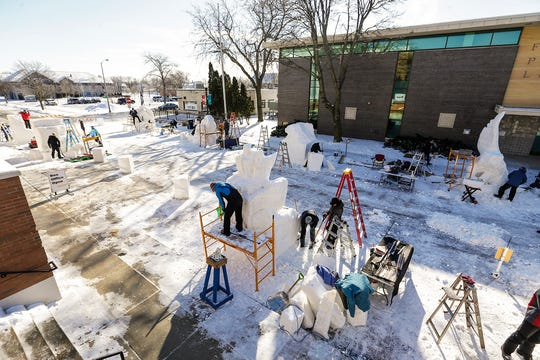 Snow sculptors work on their projects Saturday, Feb. 9, 2019, on Sheboygan Street in Fond du Lac during Sturgeon Spectacular. Sturgeon Spectacular is a weeklong celebration of the lake sturgeon spearing season and includes events on and off the ice in the Fond du Lac area.