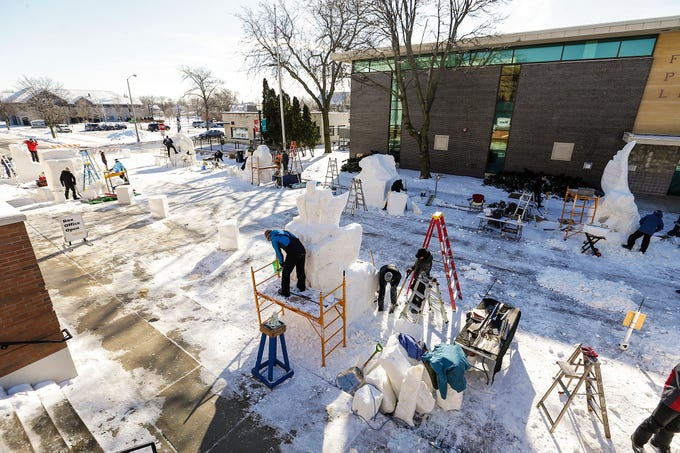 Snow sculptors work on their projects Saturday, February 9, 2019 on Sheboygan Street in Fond du Lac during Sturgeon Spectacular. Sturgeon Spectacular is a weeklong celebration of the lake sturgeon spearing season and includes events on and off the ice in the Fond du Lac area. Doug Raflik/USA TODAY NETWORK-Wisconsin