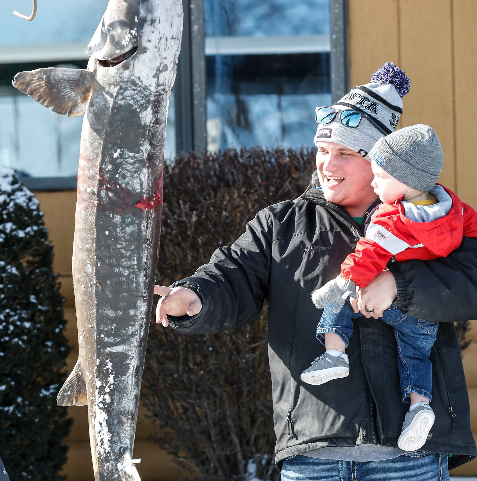 Opening day of sturgeon spearing season sees excitement, big fish despite chilly weather