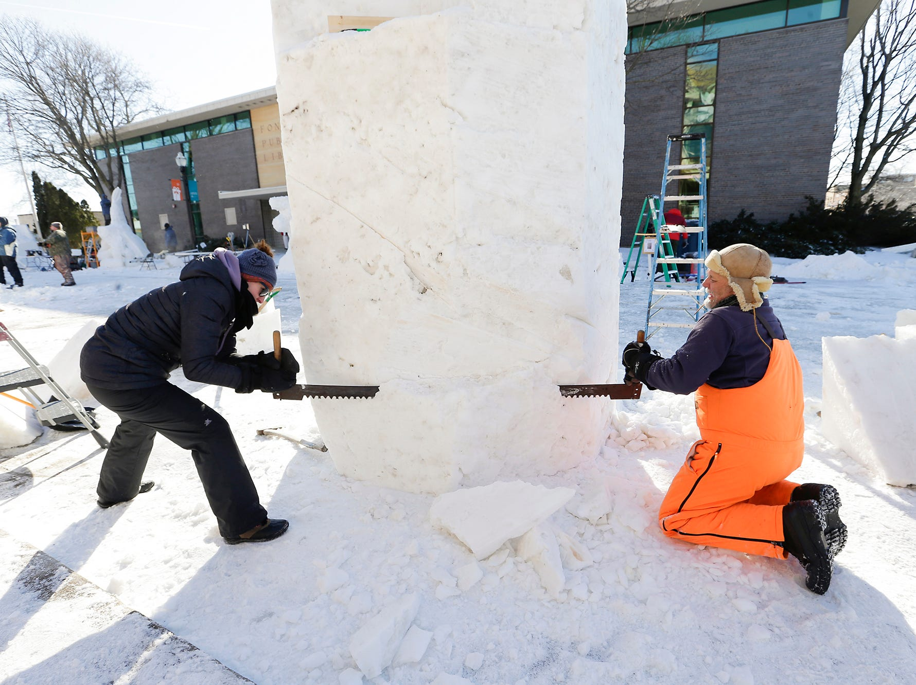 Kelly Norton of Fond du Lac and Rick Mergen of Baraboo work on a snow sculpture Saturday, February 9, 2019 in downtown Fond du Lac during Sturgeon Spectacular. Sturgeon Spectacular is a weeklong celebration of the lake sturgeon spearing season and includes events on and off the ice in the Fond du Lac area. Doug Raflik/USA TODAY NETWORK-Wisconsin