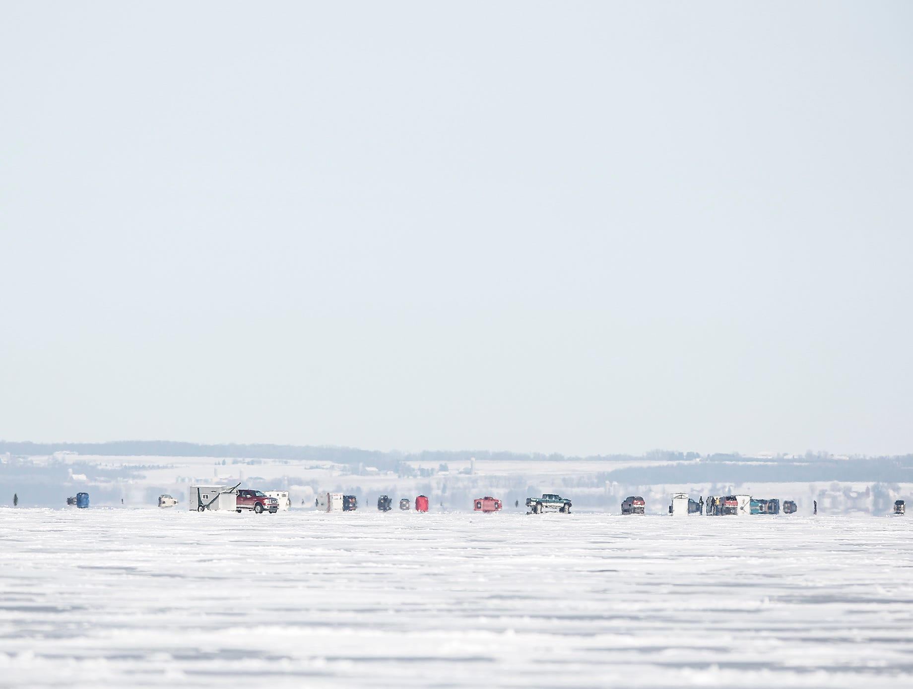 A scattering of fish shanties dots the horizon Saturday, February 9, 2019 on Lake Winnebago  between Fond du Lac and Oshkosh. Sturgeon spearing season runs from February 9, 2019 through February 24, 2019 on Lake Winnebago or until any