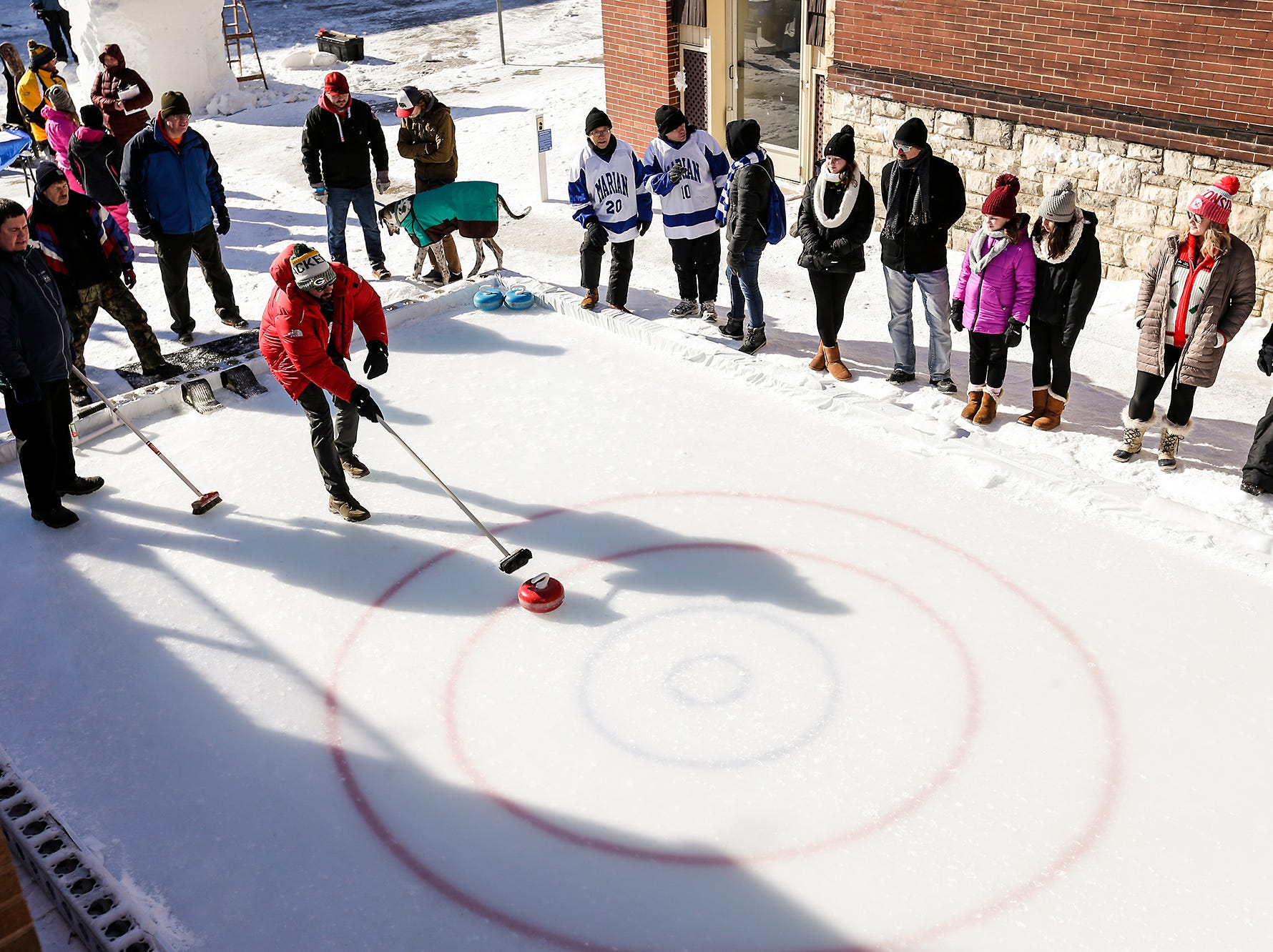 Eric Toney of Fond du Lac takes part in a curling game Saturday, February 9, 2019 in downtown Fond du Lac during Sturgeon Spectacular. Sturgeon Spectacular is a weeklong celebration of the lake sturgeon spearing season and includes events on and off the ice in the Fond du Lac area. Doug Raflik/USA TODAY NETWORK-Wisconsin