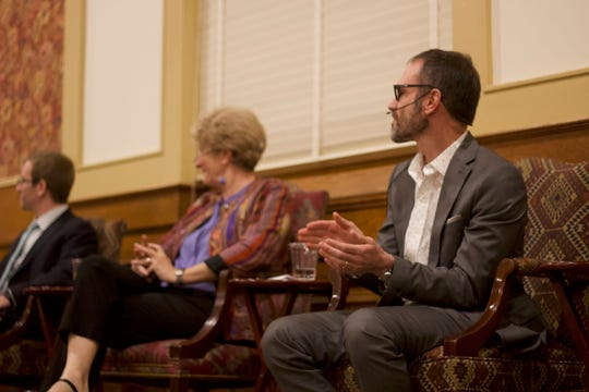 Dan Leshem (right) emphasized the power of education in ending discrimination.
