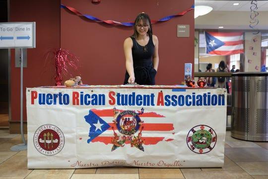 Fabiola De Leon, public relations chair for the Puerto Rican Student Association, stands at the Global Café event.