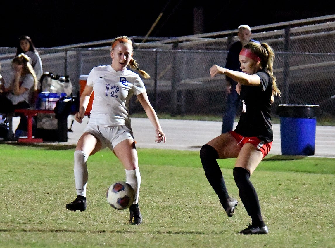 North Fort Myers High School Anna Carter(16) tries to manipulate ball control from Cape Coral High School's Kailee Kefer (12) during the regional semifinal game, Friday, Feb. 8, 2019.