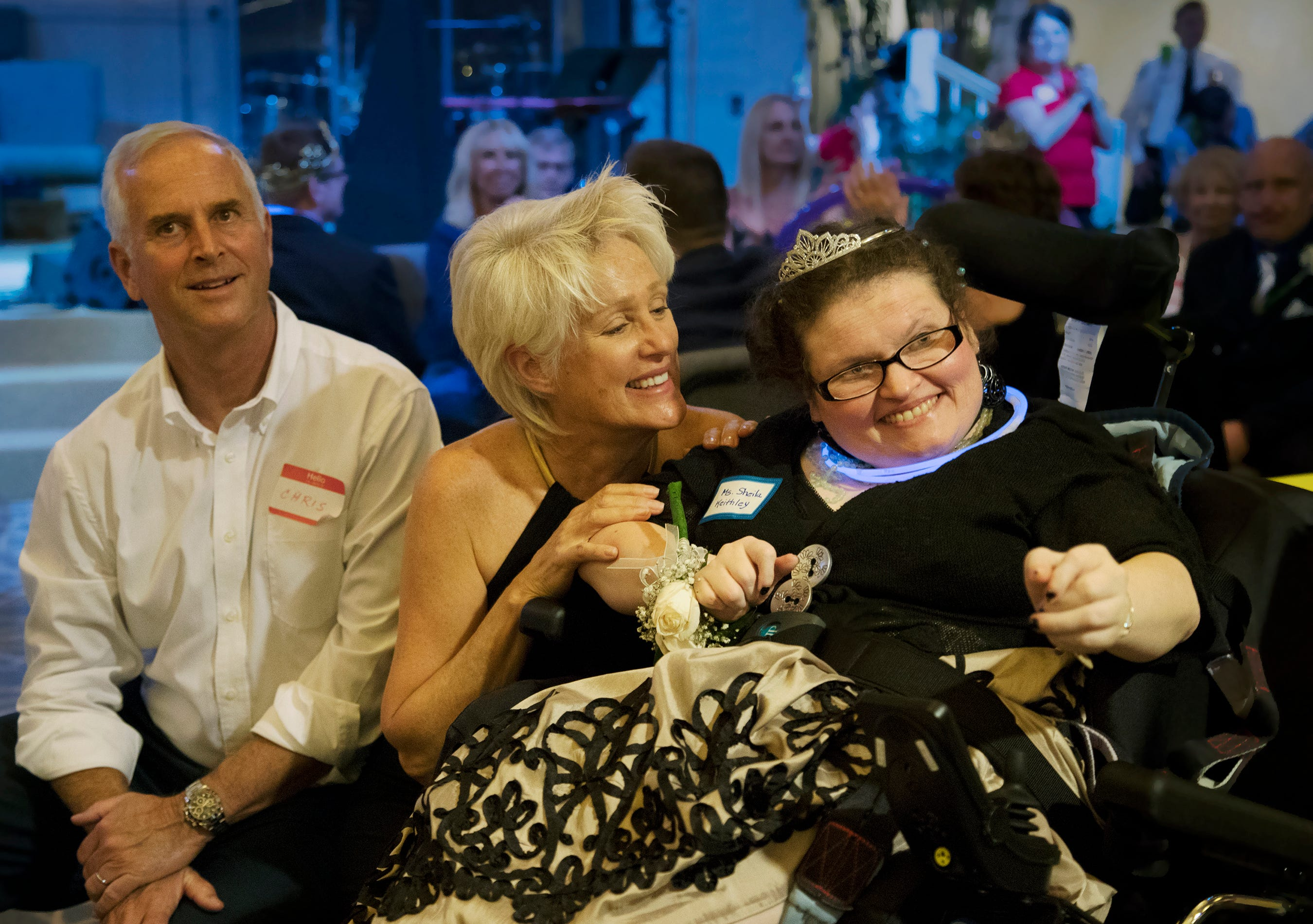 "Judy Peterson, center, celebrates with Sheila Keithley, right, during the ""Night to Shine"" event on Friday at Sanibel Community Church on Sanibel Island. The annual event celebrates people with special needs and is presented by the Tim Tebow Foundation. More than 600 churches across the country participated."
