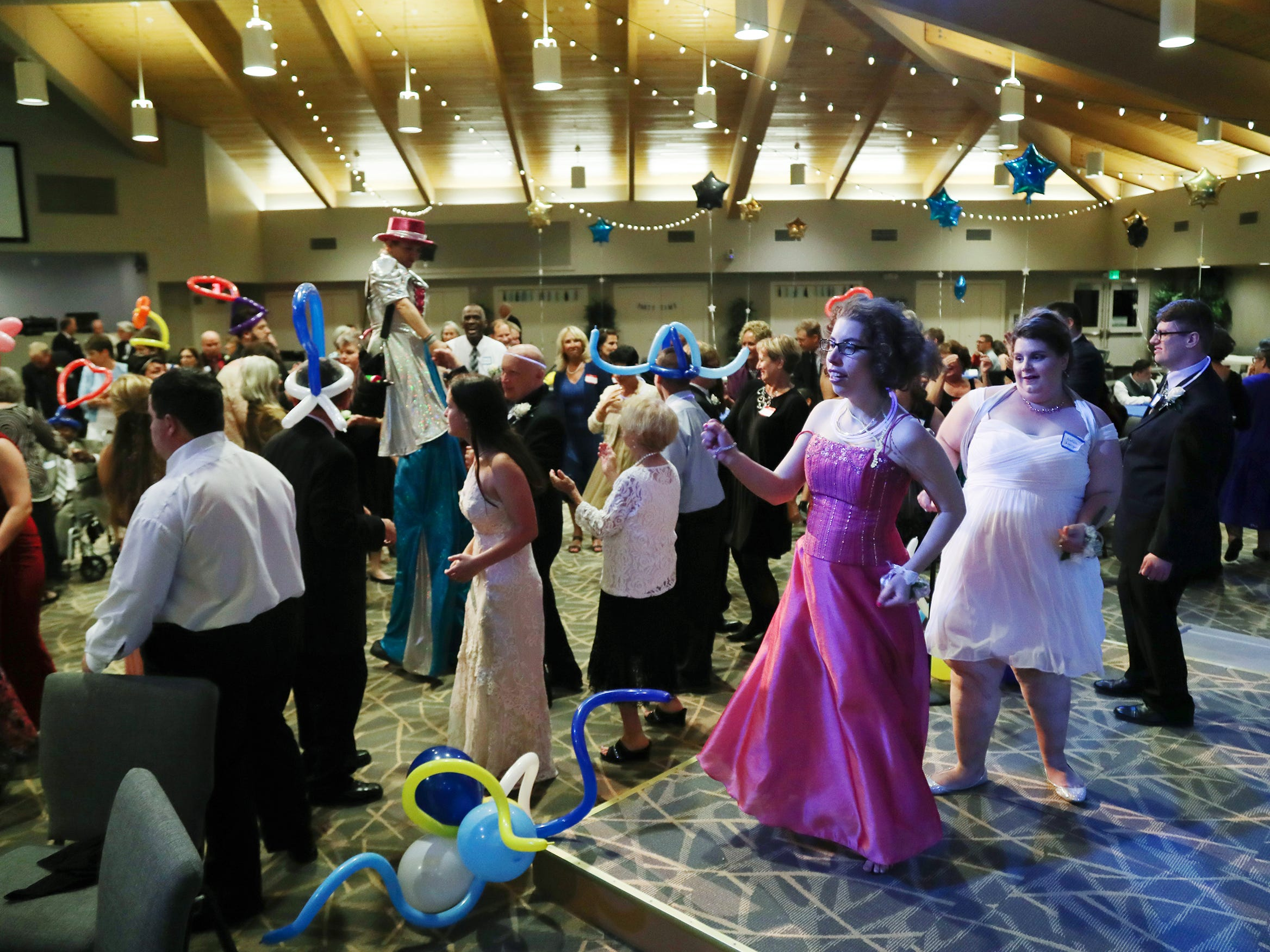 "Isis Gutierrez, right, dances during the ""Night to Shine"" event on Friday at Sanibel Community Church on Sanibel Island. The annual event celebrates people with special needs and is presented by the Tim Tebow Foundation. More than 600 churches across the country participated."