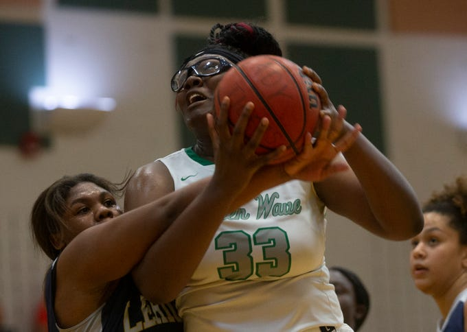 Fort Myers' Chaniya Clark (33) attempts a shot over Lehigh's Aliesha Curry (13), Friday, Feb. 8, 2019, at Dunbar High School in Fort Myers.