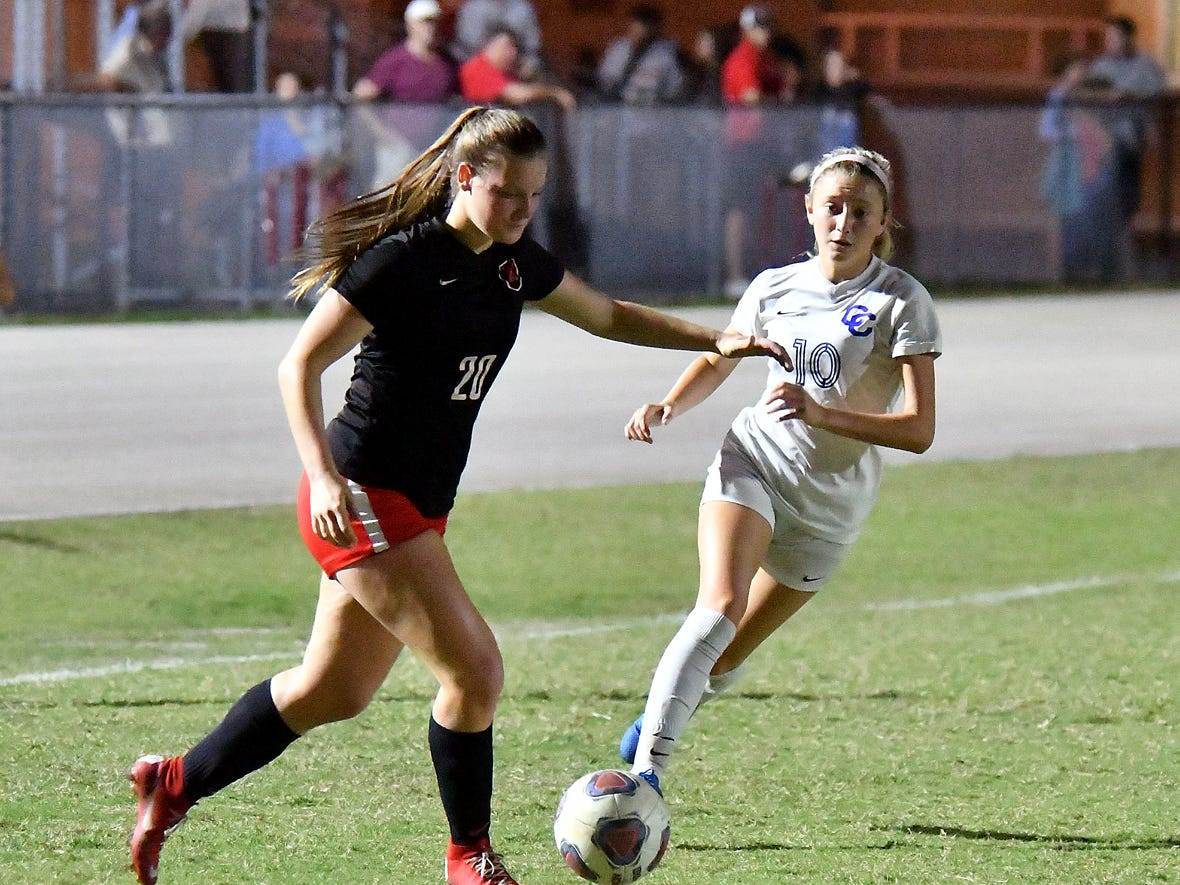 North Fort Myers High School's Lauren Gargiula (20) tries to get around Cape Coral High School's Kailee Kefer (10) during the regional semifinal game, Friday, Feb. 8, 2019.