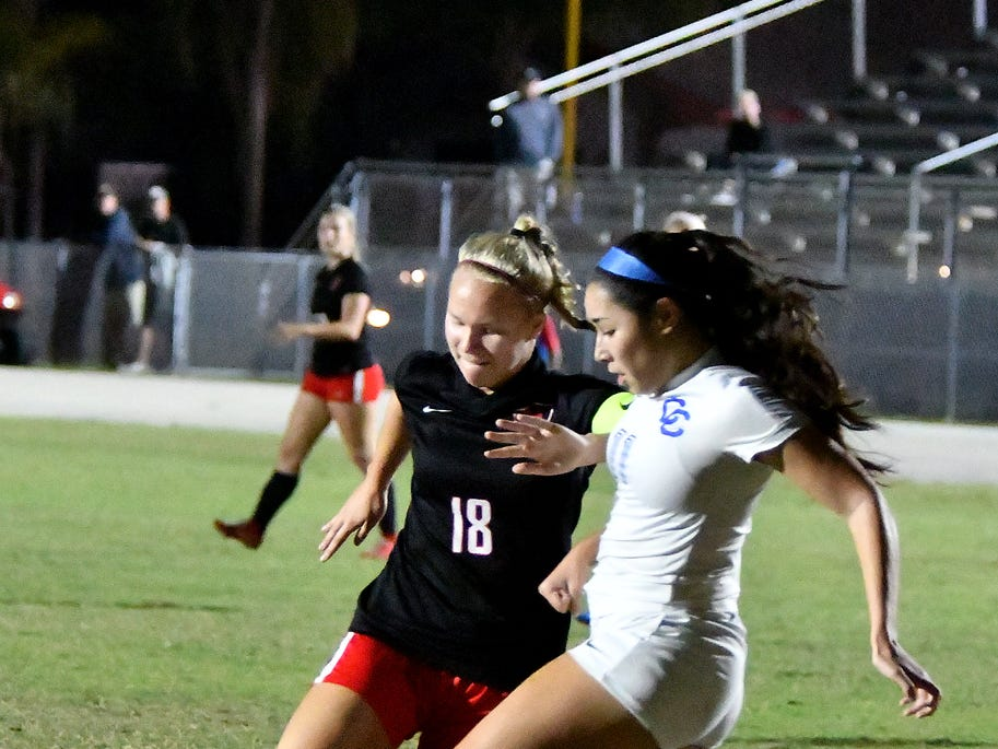 North Fort Myers High School Emilee Hauser(18) tries to get around Cape Coral High School's Valerie Lara (11) during the regional semifinal game, Friday, Feb. 8, 2019.
