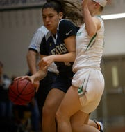 Lehigh's Anayah Molina attempts to move the ball past Fort Myers' Aliesha Curry, Friday, Feb. 8, 2019, at Dunbar High School in Fort Myers.