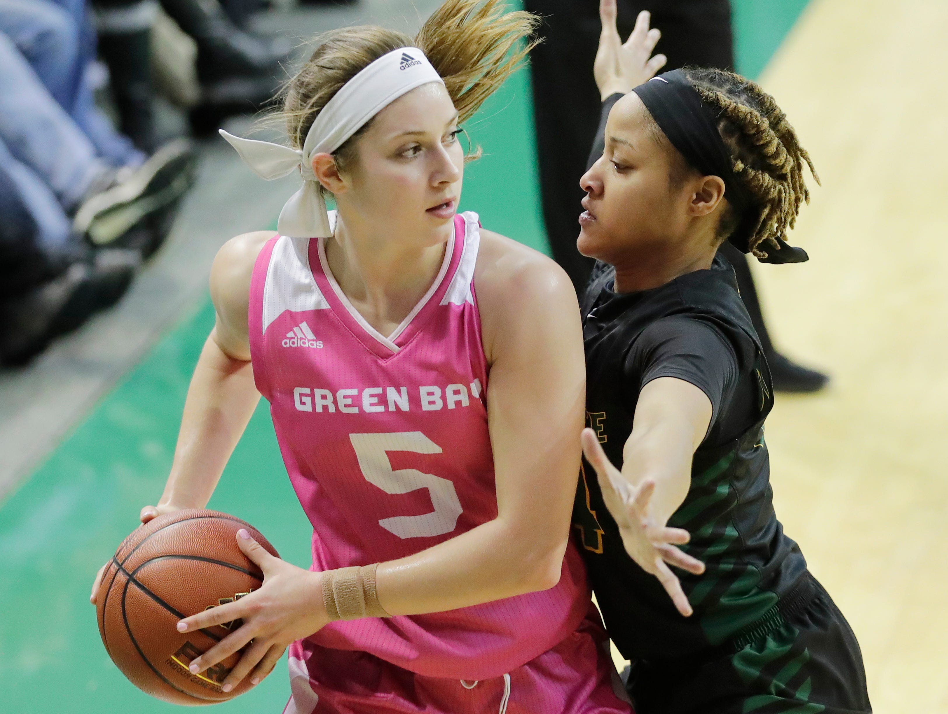 Wright State Raiders guard Michal Miller (24) guards Green Bay Phoenix guard Laken James (5) in a Horizon League women's basketball game at the Kress Center on Saturday, February 9, 2019 in Green Bay, Wis.