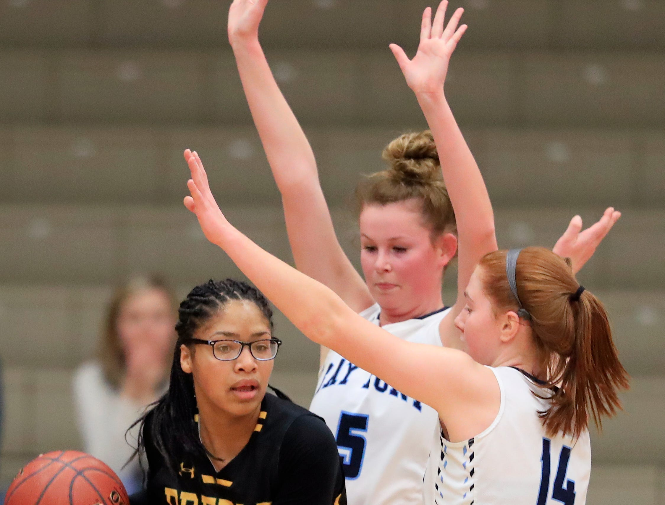 Green Bay Preble's Dominique King (25) gets trapped by Bay Port's Alaina Abel (14) and Peyton Coughlin (5) in a FRCC girls basketball game at Bay Port high school on Friday, February 8, 2019 in Suamico, Wis.