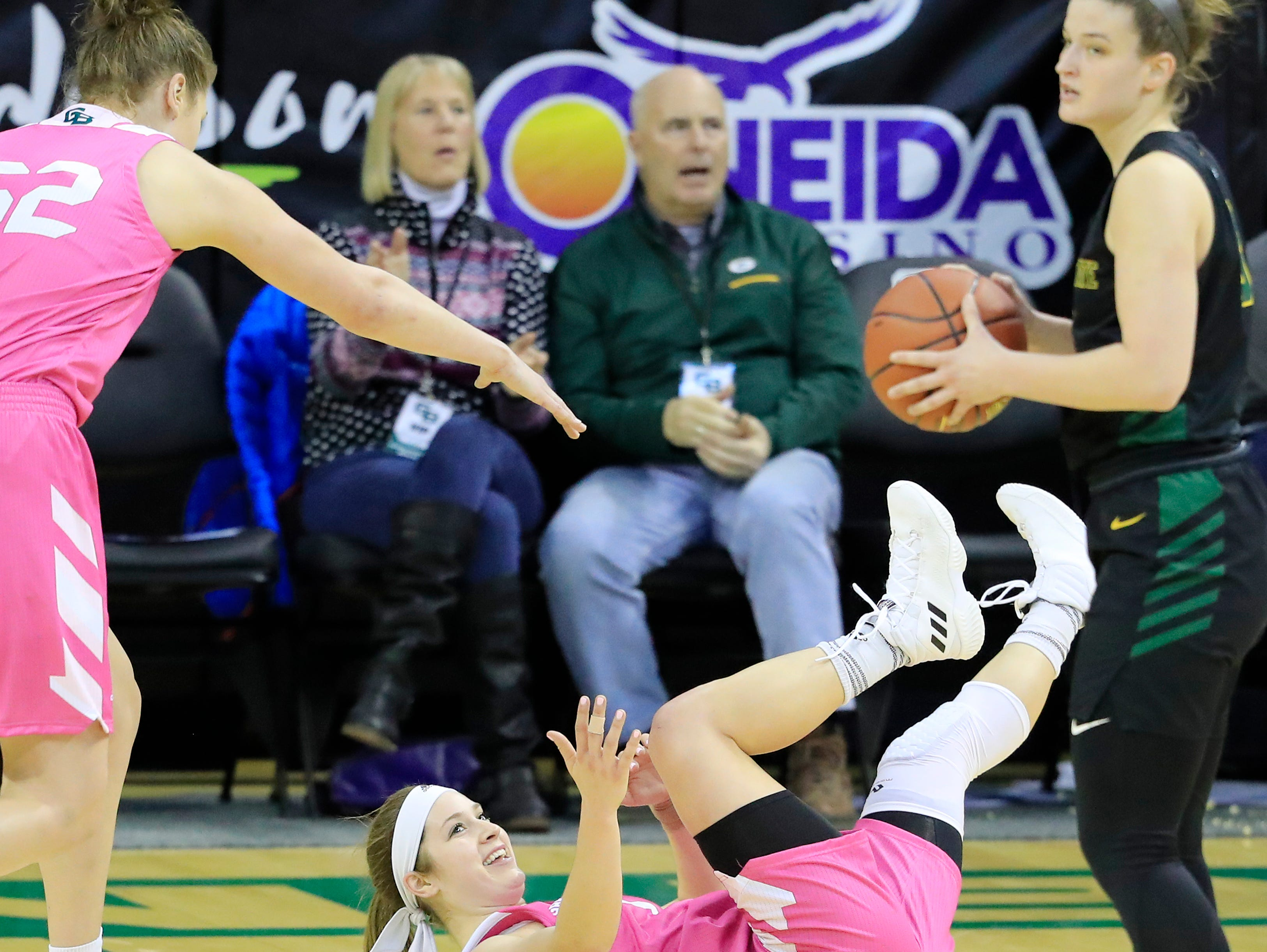 Green Bay Phoenix guard Laken James (5) draws a charge in the first half against the Wright State Raiders in a Horizon League women's basketball game at the Kress Center on Saturday, February 9, 2019 in Green Bay, Wis.