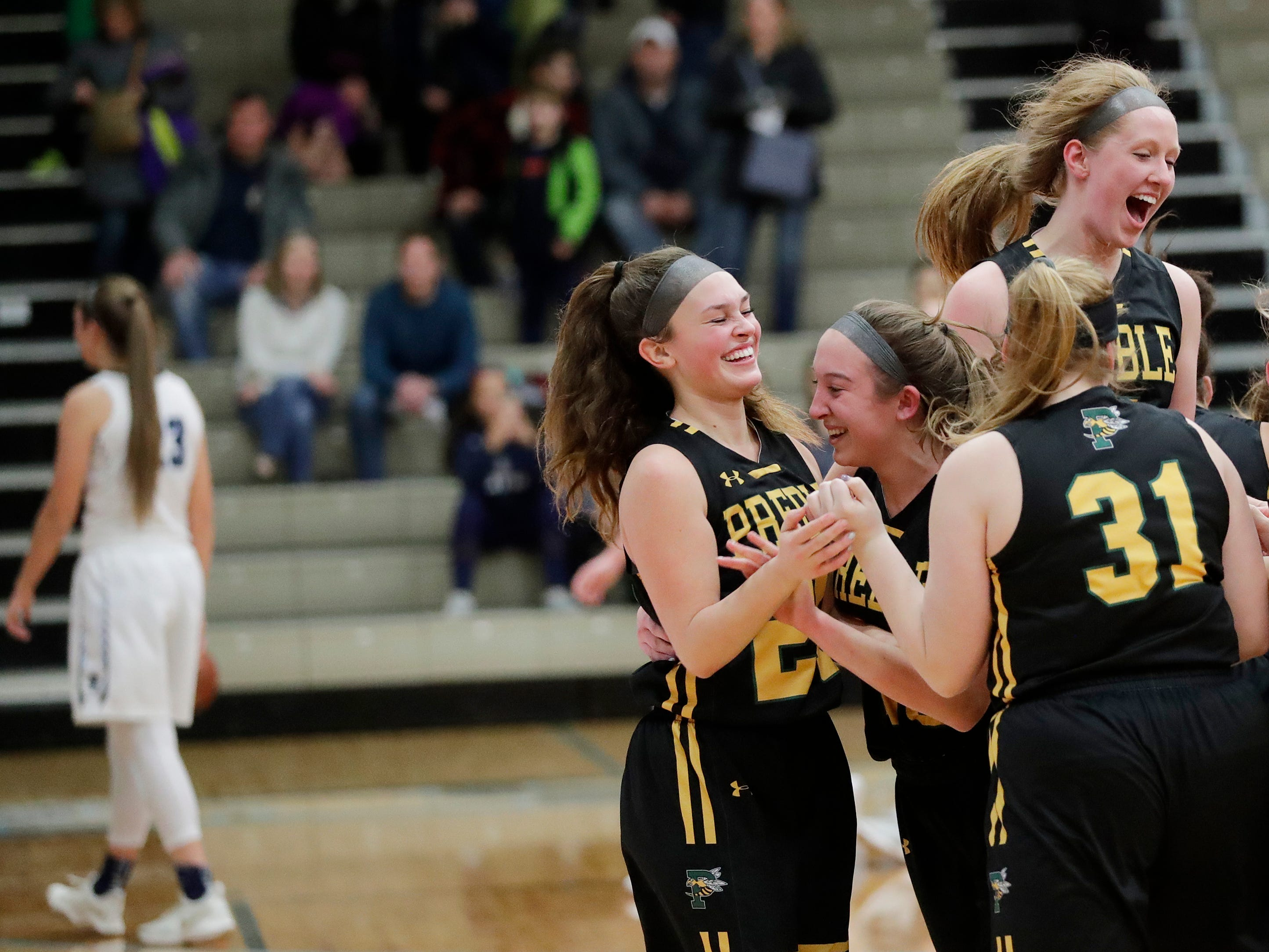 Green Bay Preble players celebrate after defeating Bay Port 61-53 in an FRCC girls basketball game at Bay Port high school on Friday, February 8, 2019 in Suamico, Wis.