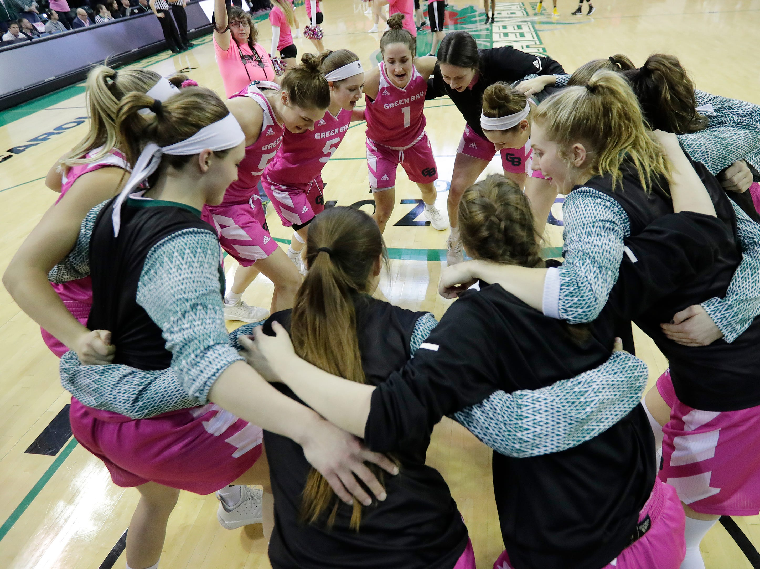 Green Bay Phoenix players huddle before facing Wright State in a Horizon League women's basketball game at the Kress Center on Saturday, February 9, 2019 in Green Bay, Wis.