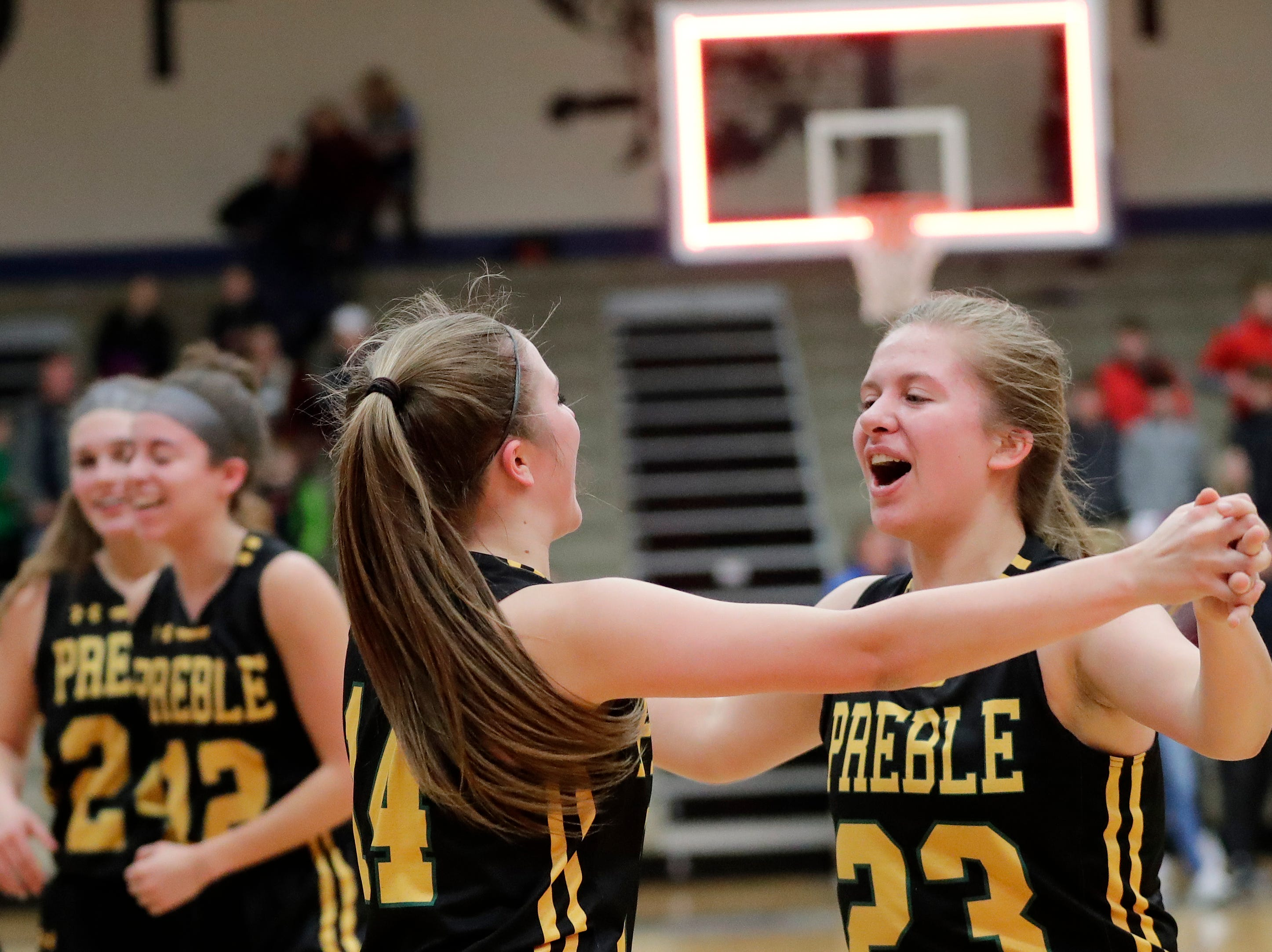 Green Bay Preble's Carley Thiry (23) celebrates with Taylor Sleger (14) after the Hornets defeated Bay Port 61-53 in an FRCC girls basketball game at Bay Port high school on Friday, February 8, 2019 in Suamico, Wis.