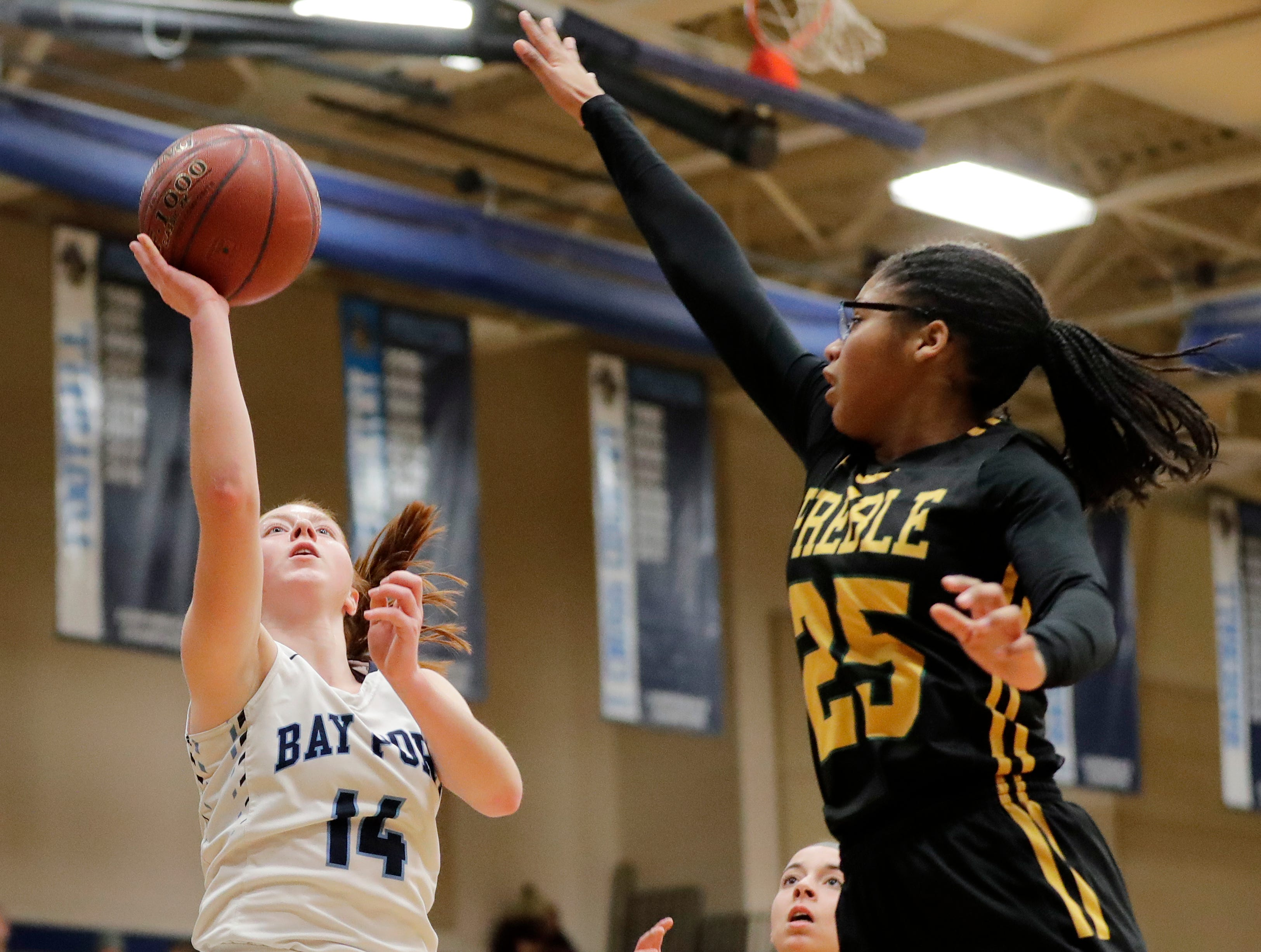 Bay Port's Alaina Abel (14) shoots against Green Bay Preble's Dominique King (25) in a FRCC girls basketball game at Bay Port high school on Friday, February 8, 2019 in Suamico, Wis.