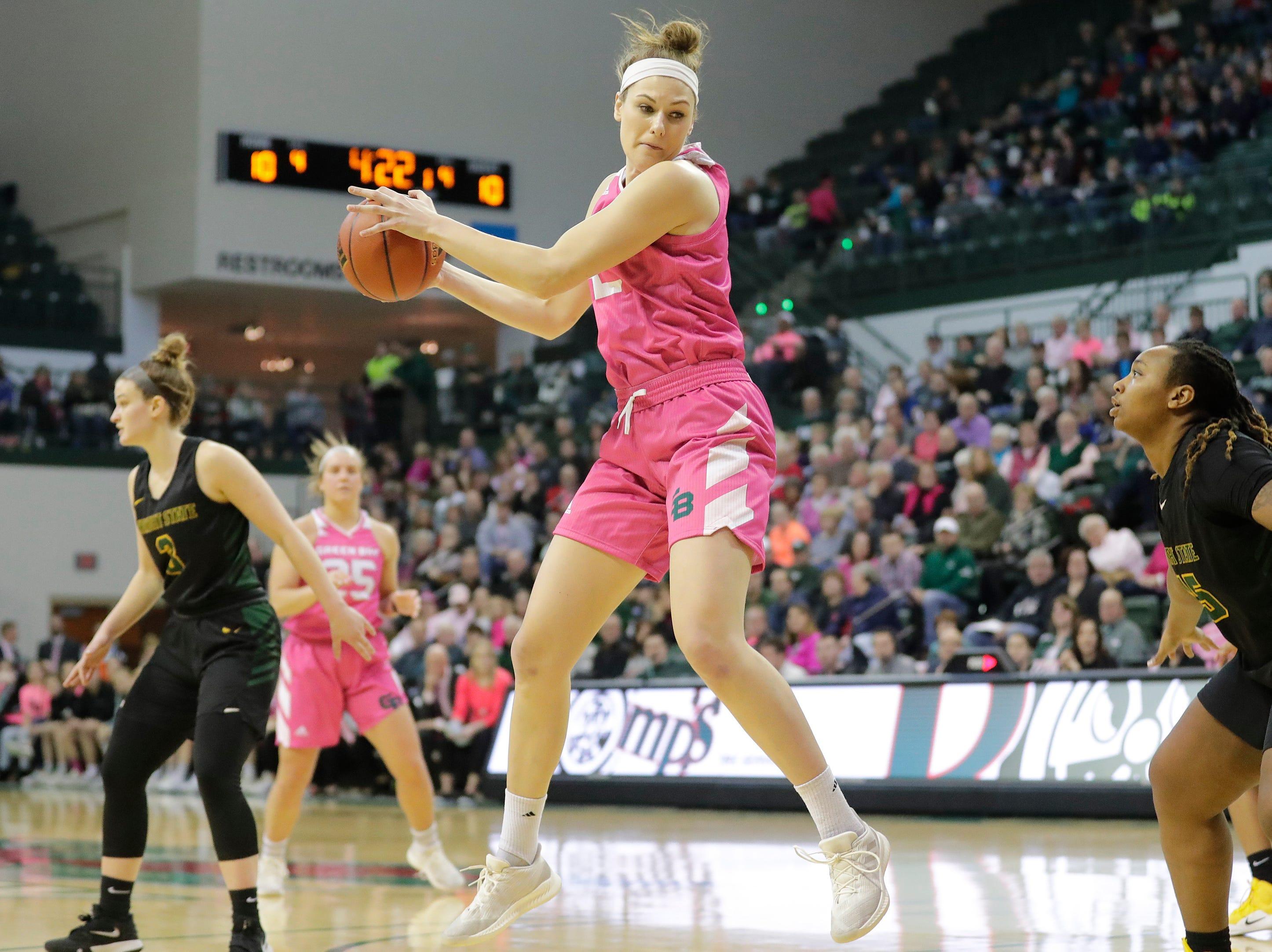 Green Bay Phoenix forward/center Mackenzie Wolf (42) catches a pass against the Wright State Raiders in a Horizon League women's basketball game at the Kress Center on Saturday, February 9, 2019 in Green Bay, Wis.