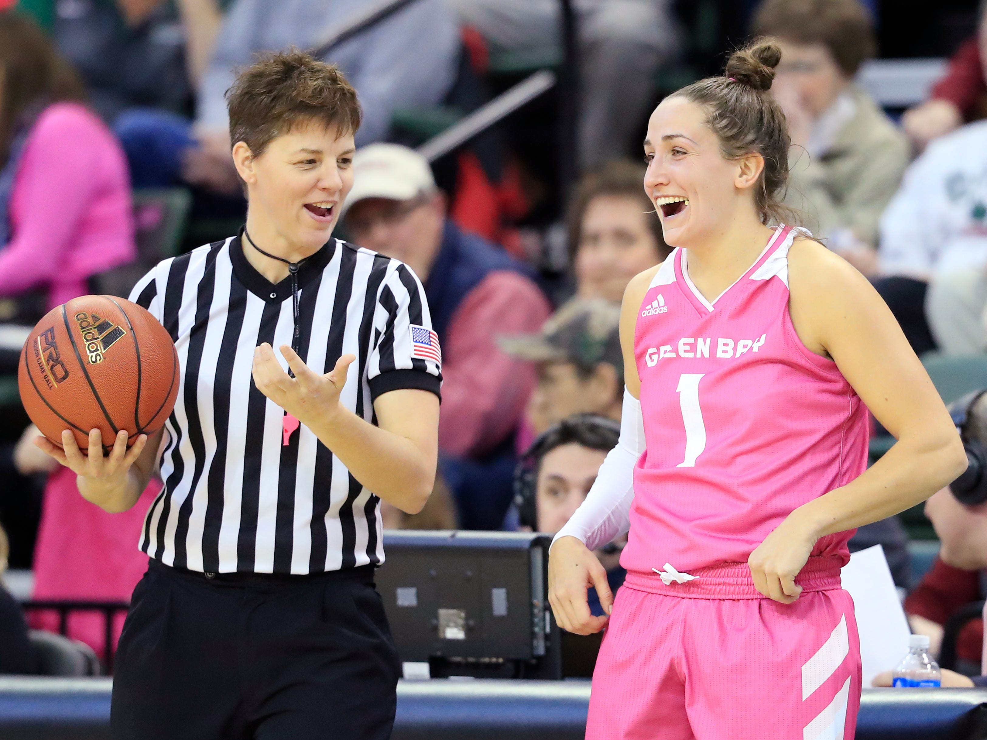 Green Bay Phoenix guard Jen Wellnitz (1) laughs with a referee at the end of a timeout against the Wright State Raiders in a Horizon League women's basketball game at the Kress Center on Saturday, February 9, 2019 in Green Bay, Wis.