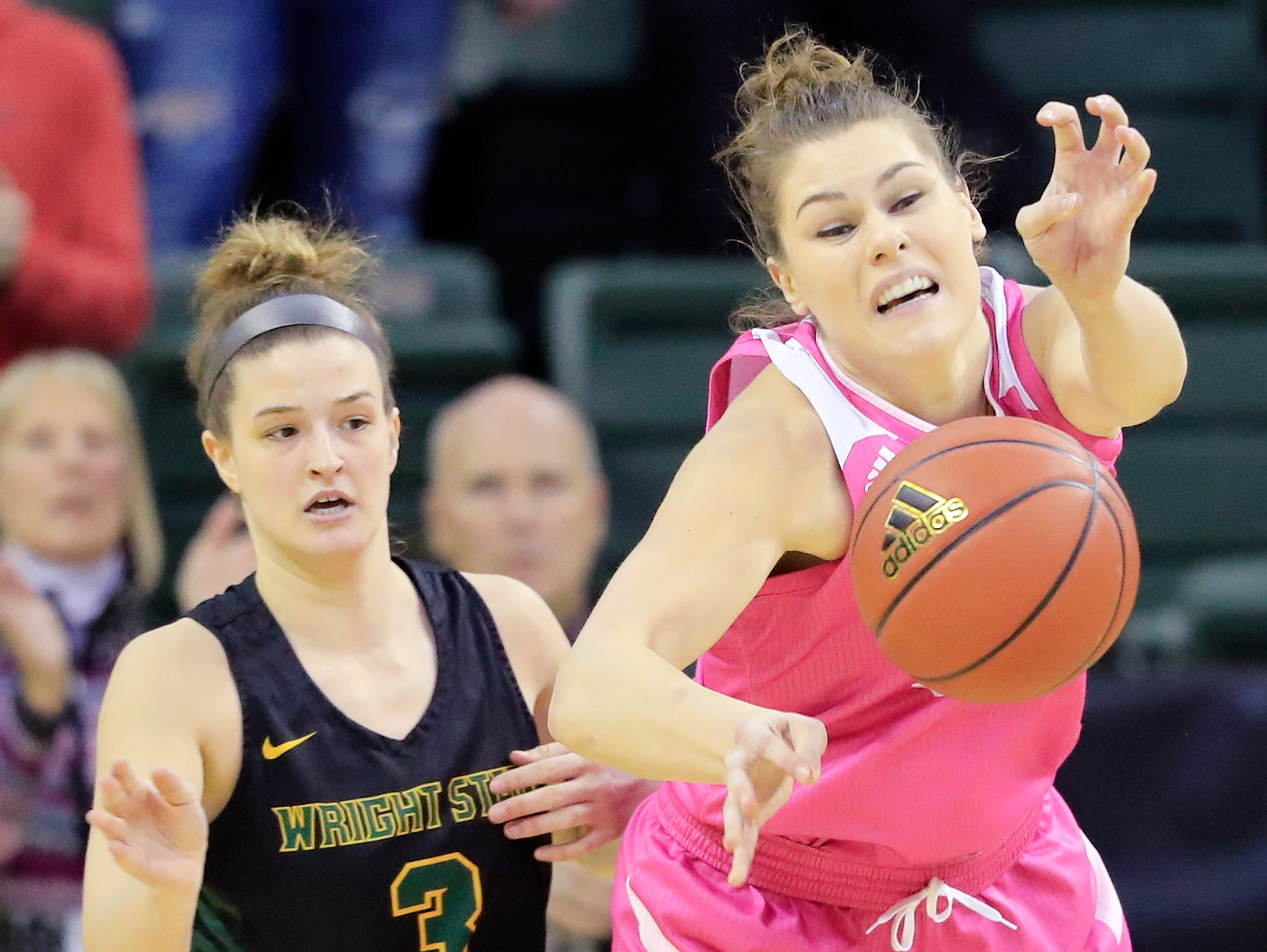 Green Bay Phoenix forward/center Madison Wolf (52) gets fouled by Wright State Raiders guard Emily Vogelpohl (3) in a Horizon League women's basketball game at the Kress Center on Saturday, February 9, 2019 in Green Bay, Wis.