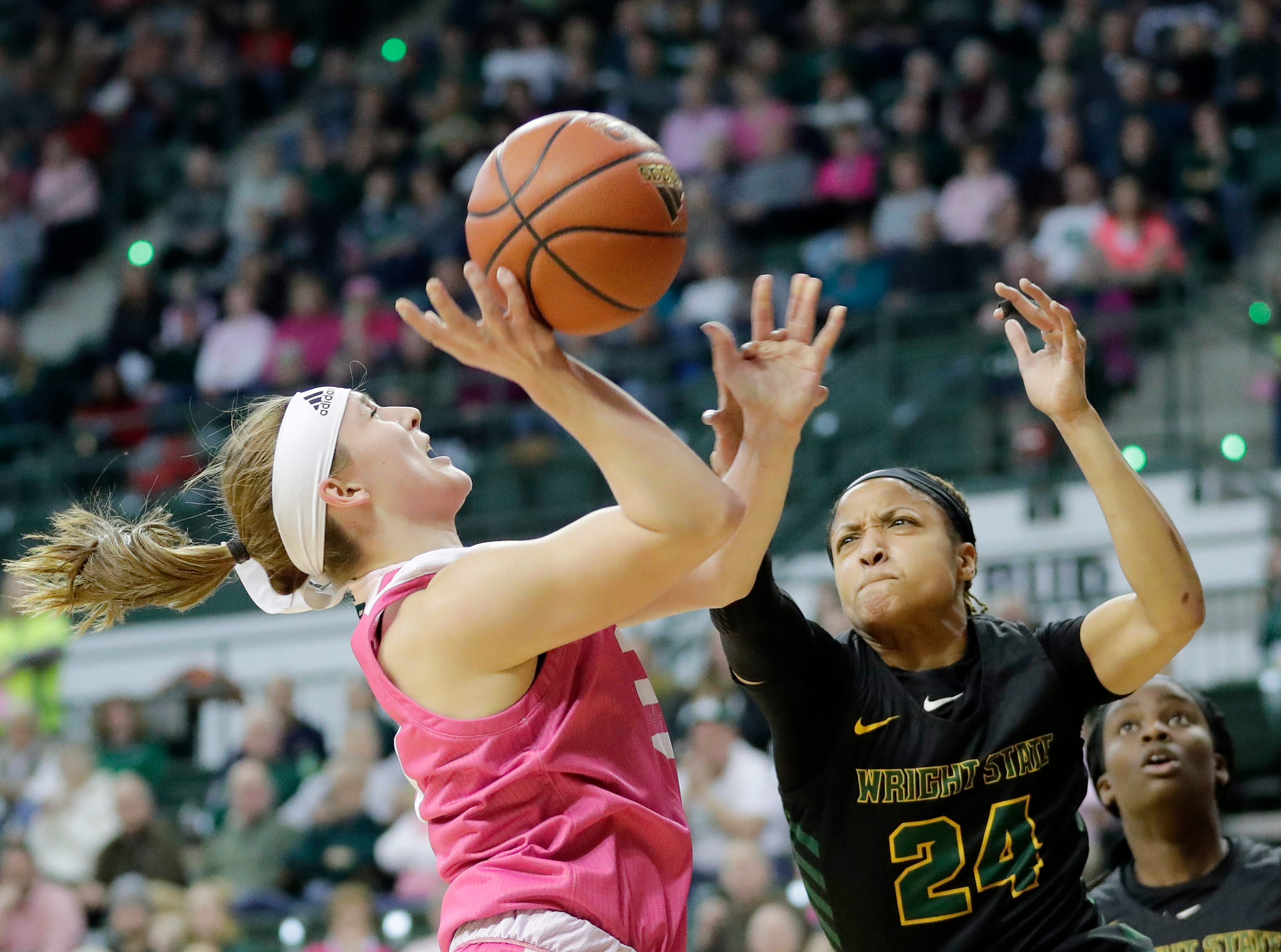 Green Bay Phoenix guard Frankie Wurtz (3) draws a foul on Wright State Raiders guard Michal Miller (24) in a Horizon League women's basketball game at the Kress Center on Saturday, February 9, 2019 in Green Bay, Wis.