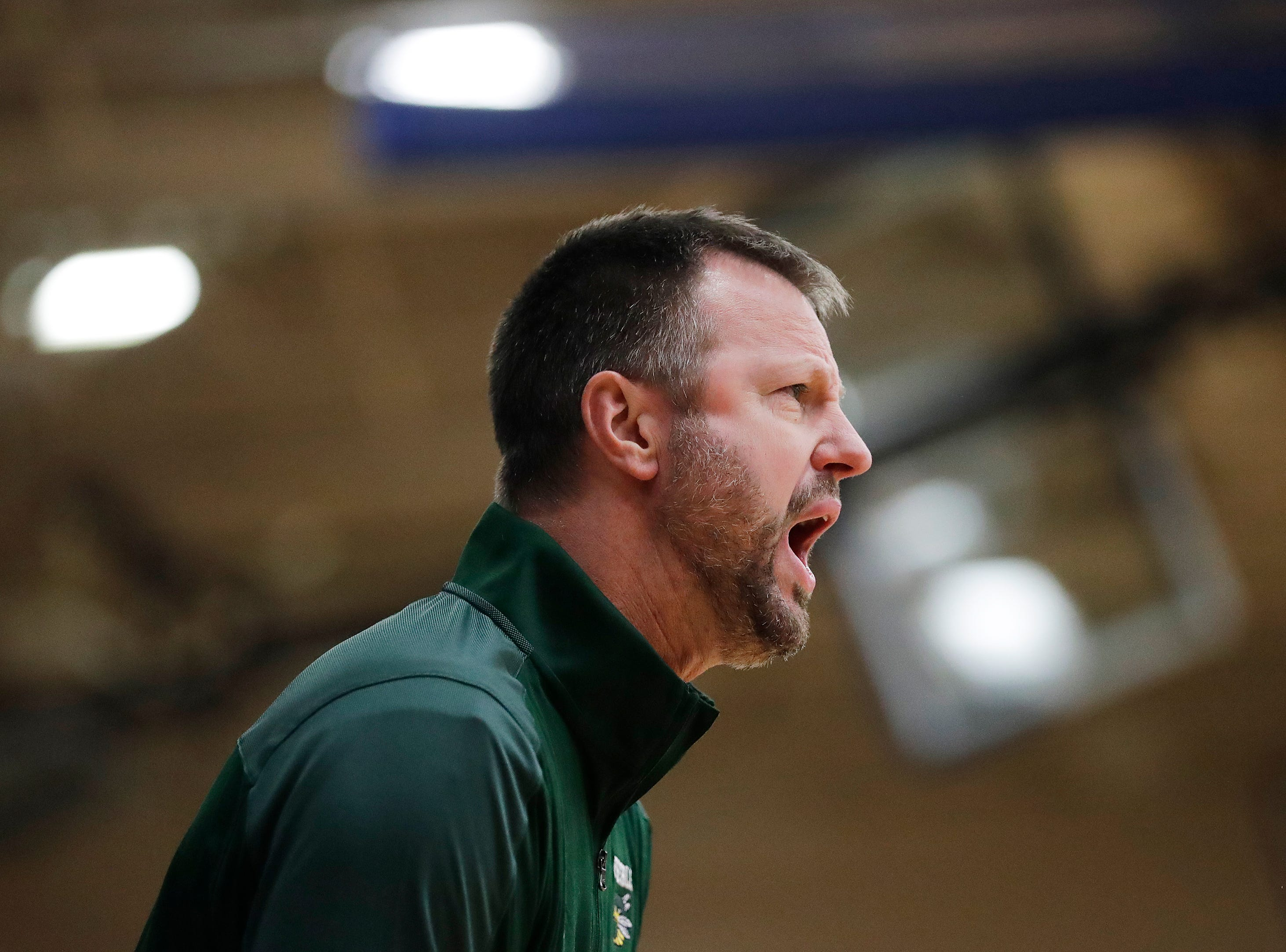 Green Bay Preble head coach Jim Doell shouts instruction during the 1st half of a FRCC girls basketball game at Bay Port high school on Friday, February 8, 2019 in Suamico, Wis.