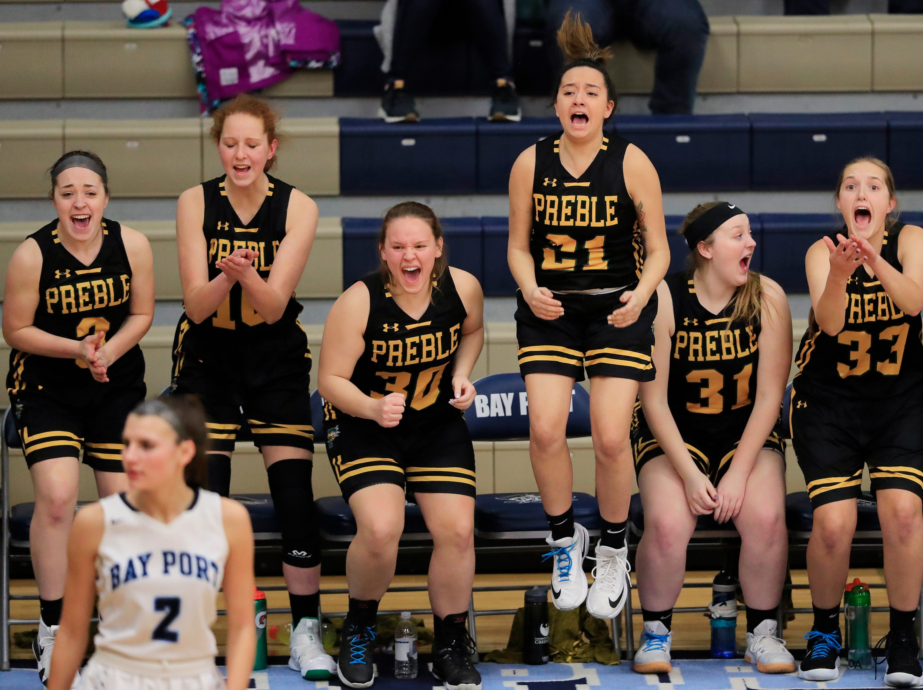 Green Bay Preble players celebrate from the bench after a basket in the final minutes against Bay Port in a FRCC girls basketball game at Bay Port high school on Friday, February 8, 2019 in Suamico, Wis.