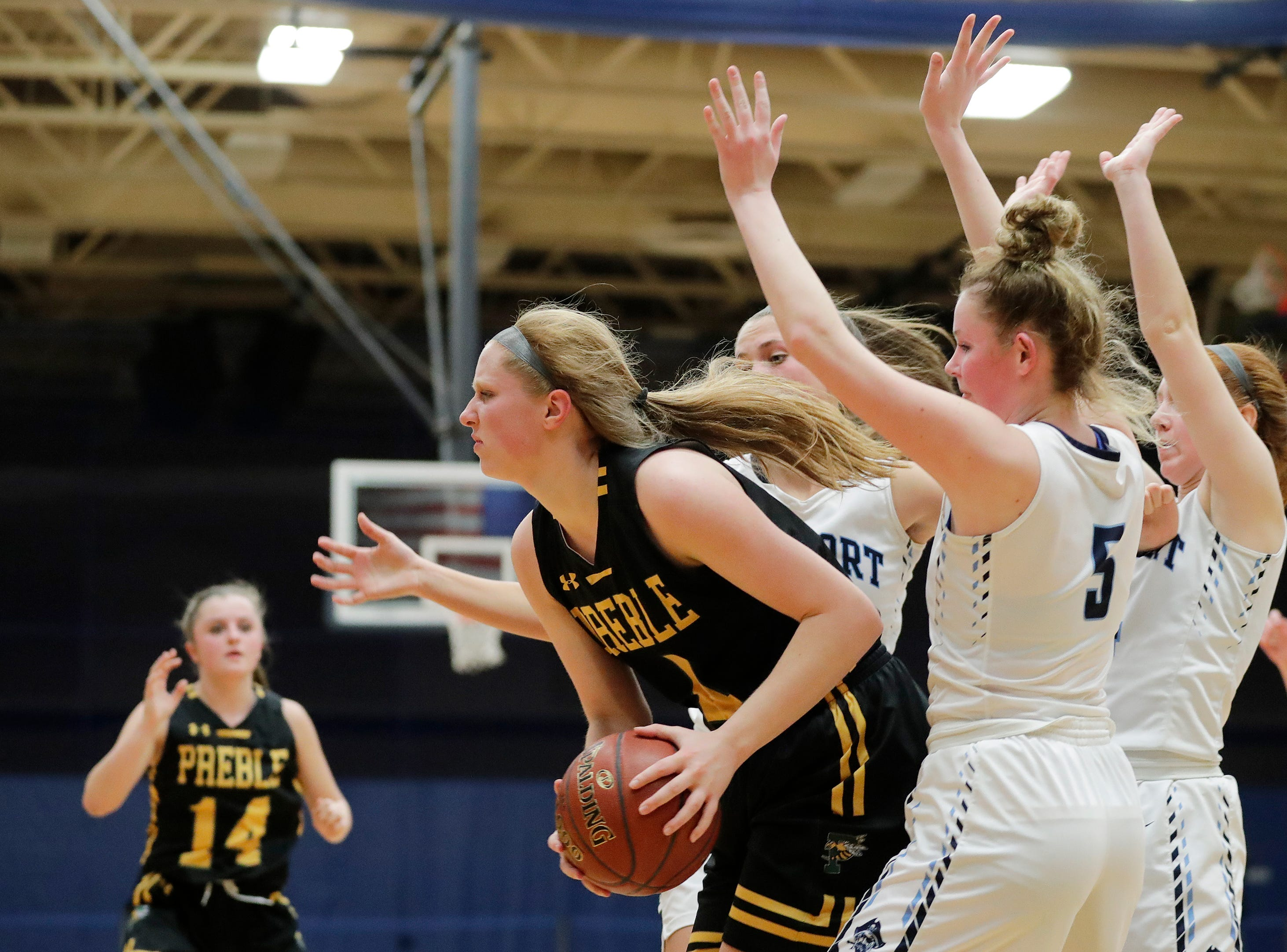 Green Bay Preble's Kendall Renard (4) draws a triple team by Bay Port in a FRCC girls basketball game at Bay Port high school on Friday, February 8, 2019 in Suamico, Wis.
