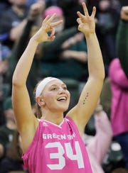 Green Bay Phoenix forward Carly Mohns (34) celebrates a Phoenix 3-pointer against Wright State on Saturday.