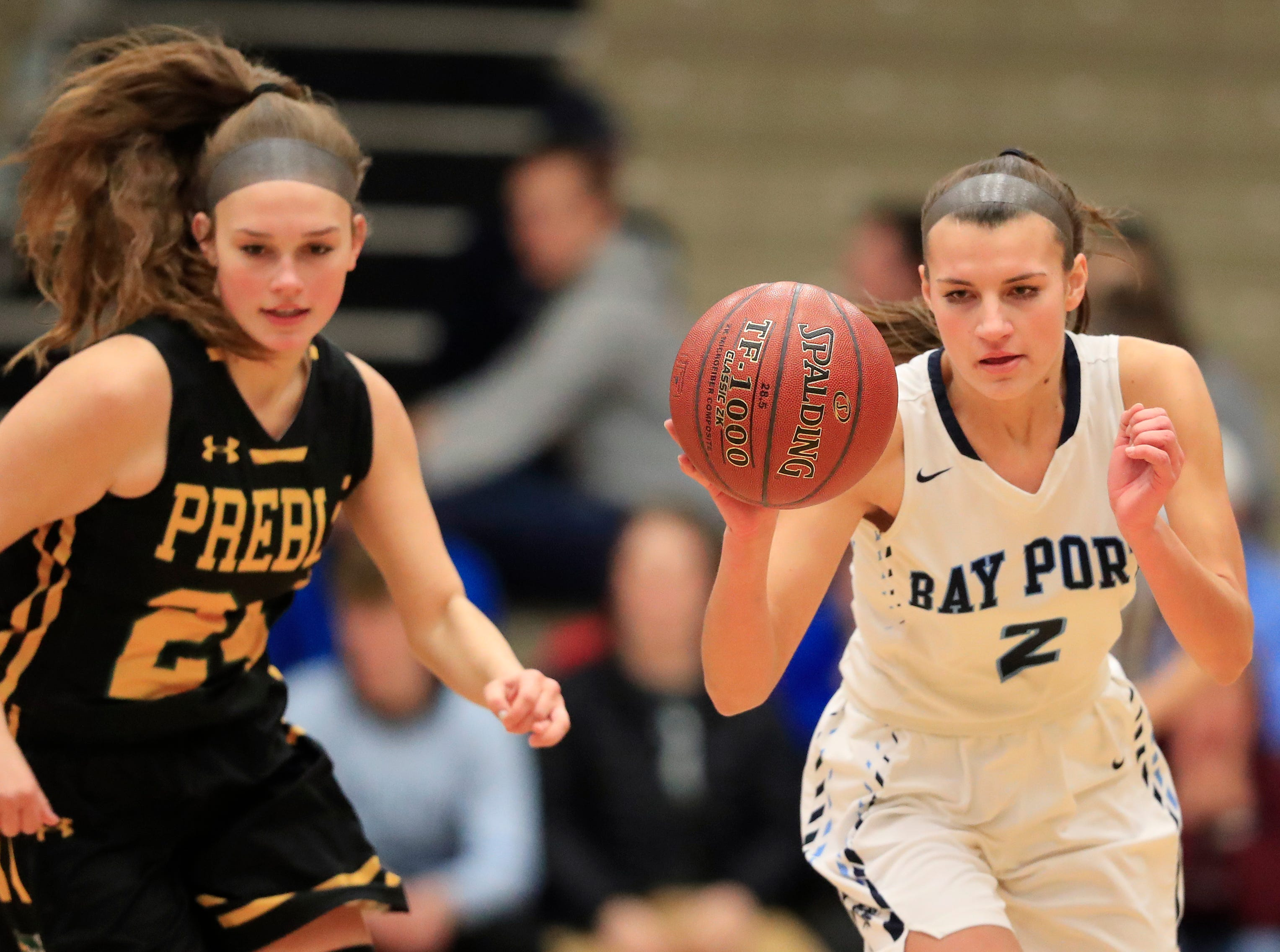 Bay Port's Grace Krause (2) steals the ball against Green Bay Preble's Ella Bialkowski (24) in an FRCC girls basketball game at Bay Port high school on Friday, February 8, 2019 in Suamico, Wis.