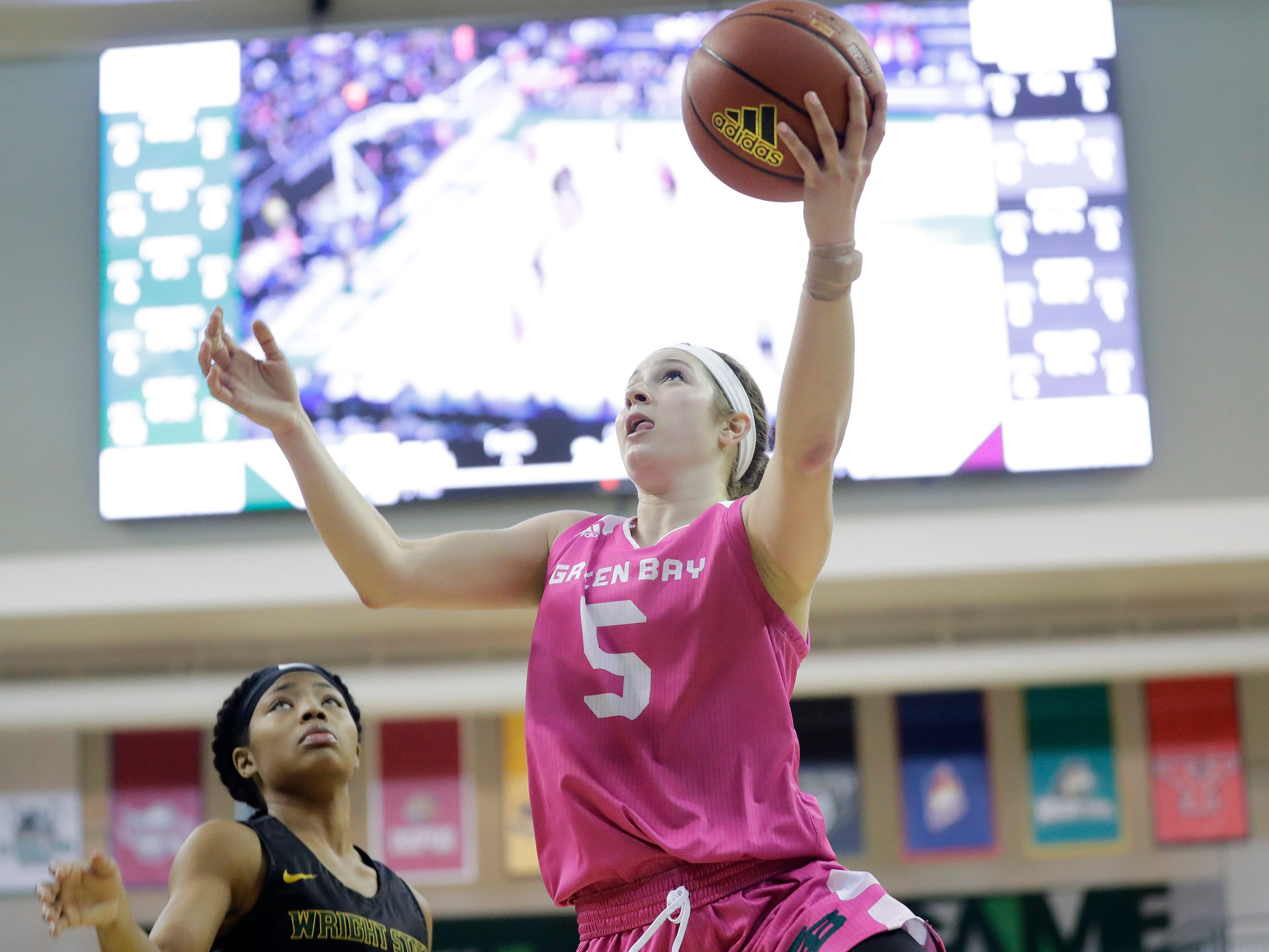 Green Bay Phoenix guard Laken James (5) scores against the Wright State Raiders in a Horizon League women's basketball game at the Kress Center on Saturday, February 9, 2019 in Green Bay, Wis.