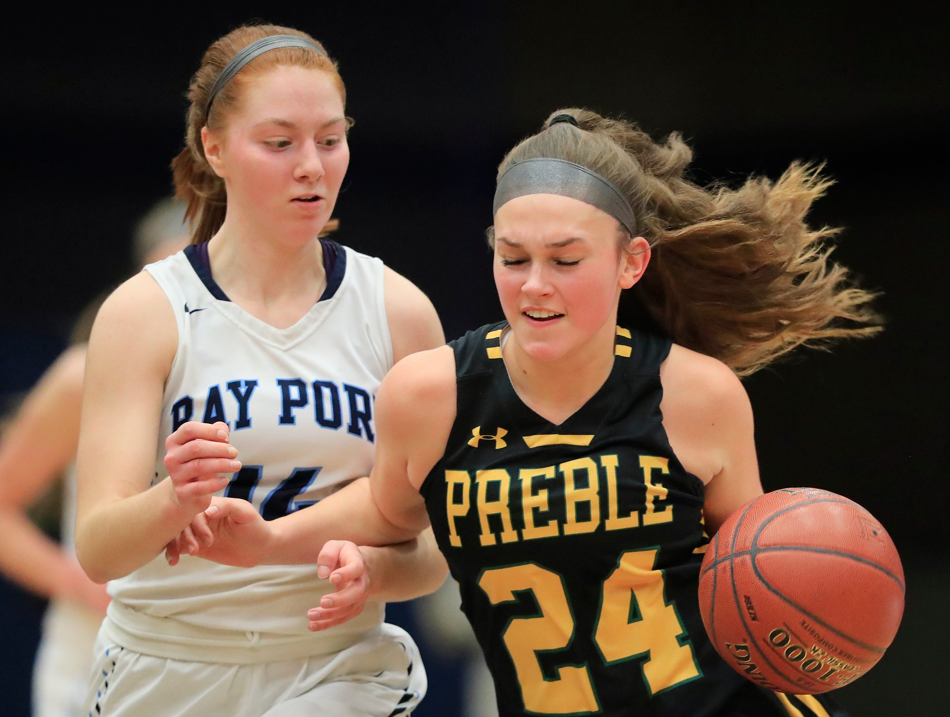Green Bay Preble's Ella Bialkowski (24) runs past Bay Port's Alaina Abel (14) in an FRCC girls basketball game at Bay Port high school on Friday, February 8, 2019 in Suamico, Wis.