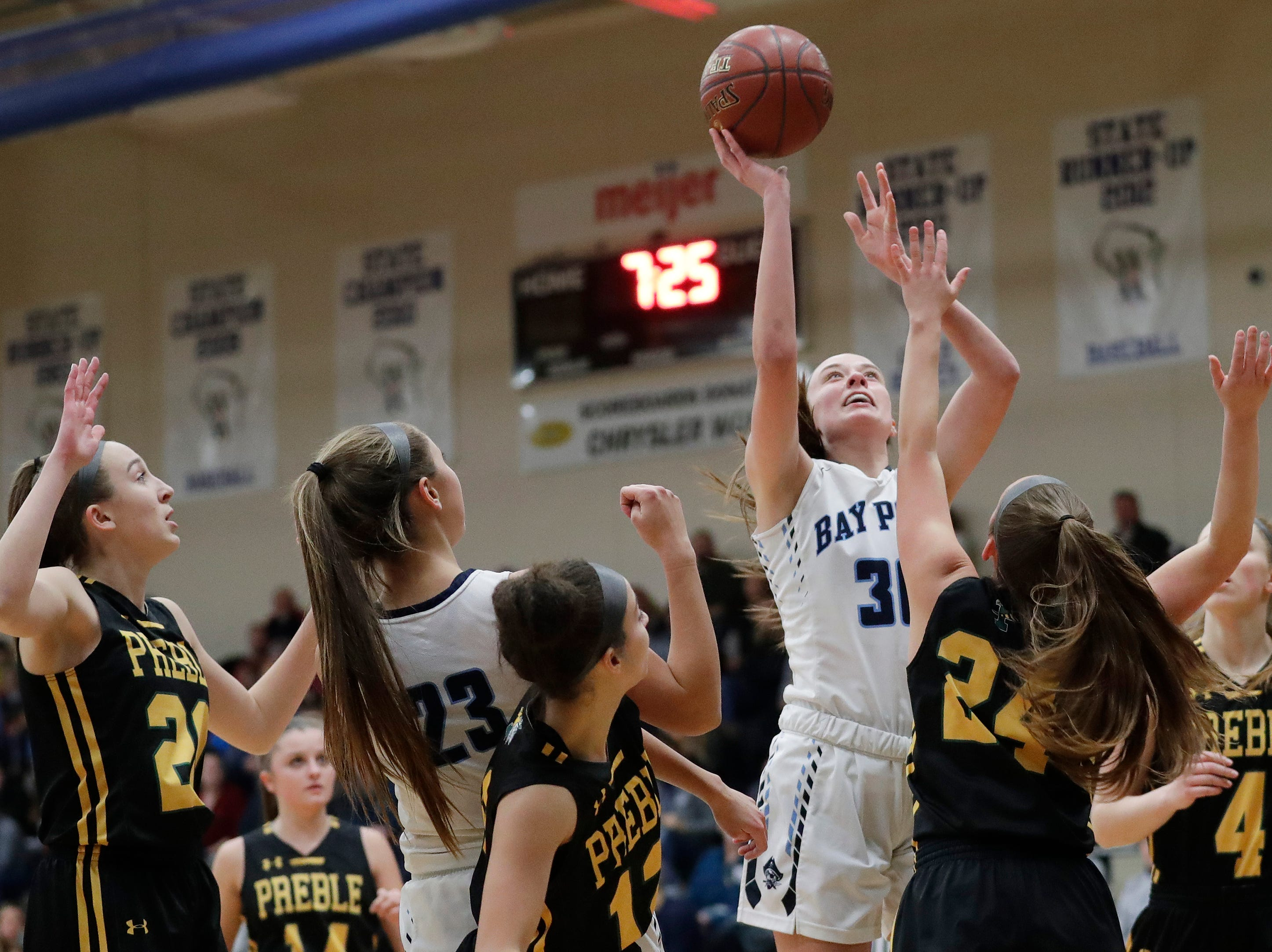 Bay Port's Mady Draak (30) shoots against Green Bay Preble in an FRCC girls basketball game at Bay Port high school on Friday, February 8, 2019 in Suamico, Wis.