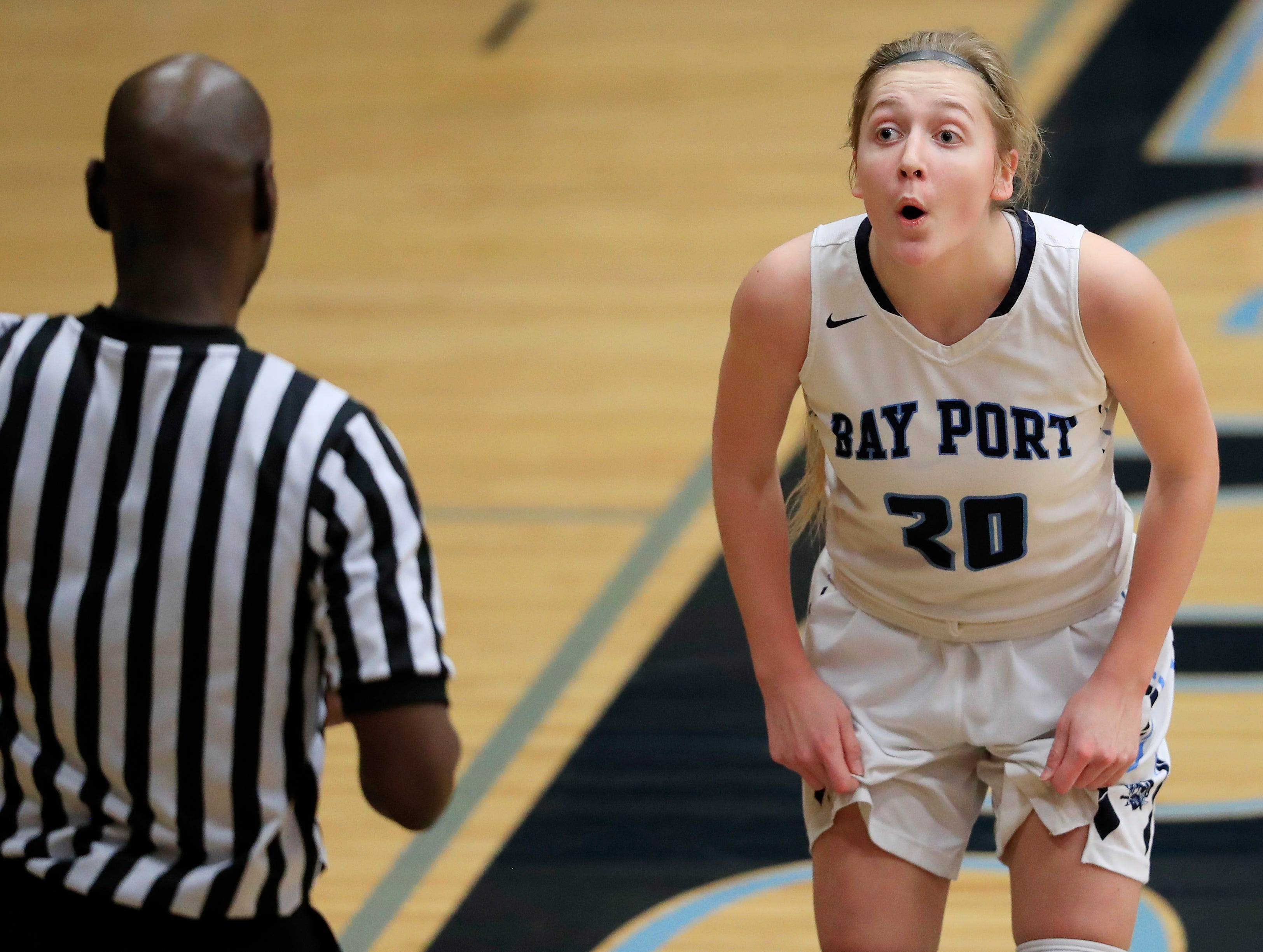 Bay Port's Reagan McIntyre (20) reacts to an out of bounds decision in a FRCC girls basketball game against Green Bay Preble at Bay Port high school on Friday, February 8, 2019 in Suamico, Wis.