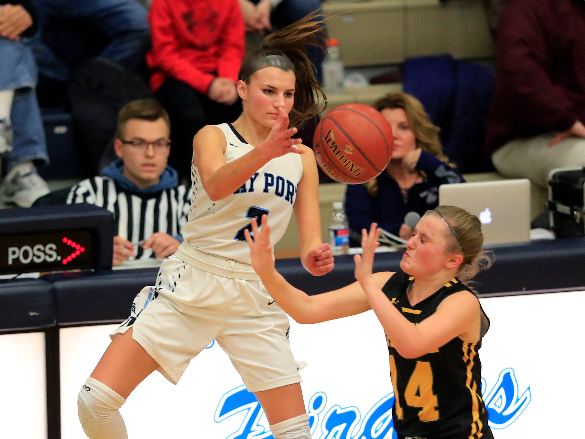 Bay Port's Grace Krause (2) is pressured by Green Bay Preble's Taylor Sleger (14) in a FRCC girls basketball game at Bay Port high school on Friday, February 8, 2019 in Suamico, Wis.