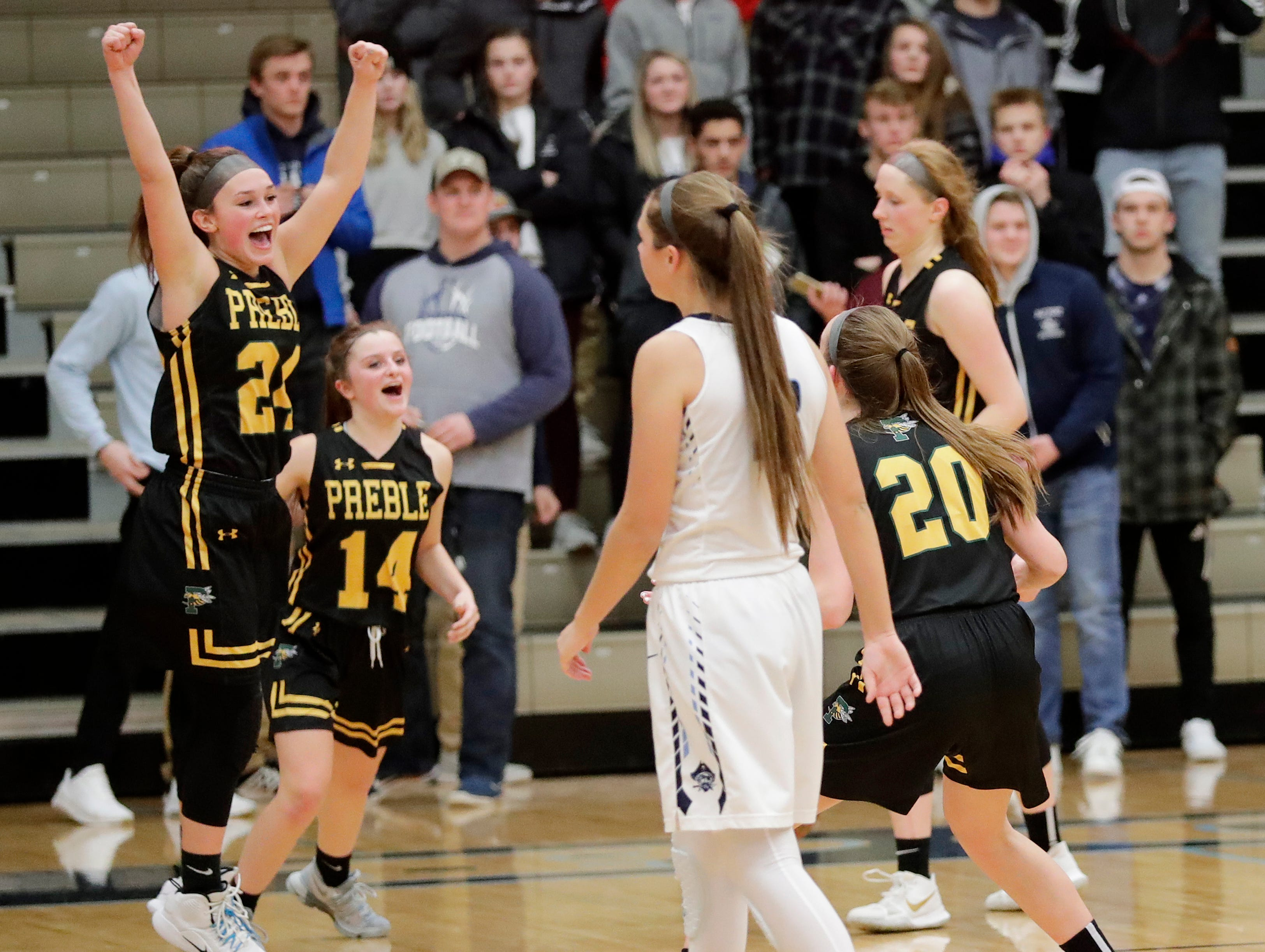 Green Bay Preble's Ella Bialkowski (24) celebrates at the buzzer against Bay Port in an FRCC girls basketball game at Bay Port high school on Friday, February 8, 2019 in Suamico, Wis.