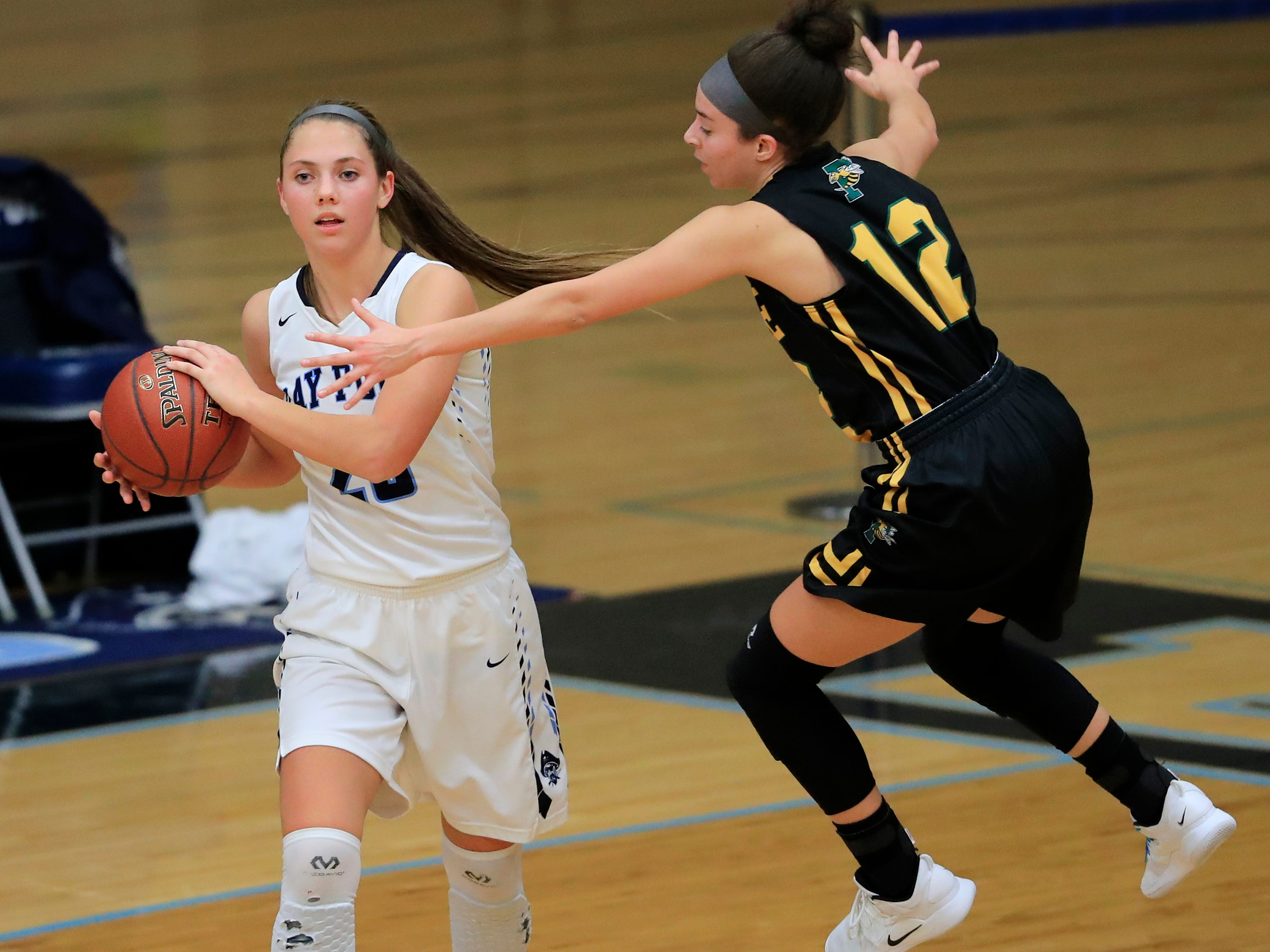 Green Bay Preble's Hannah Beauchamp (12) guards Bay Port's Emma Nagel (23) in a FRCC girls basketball game at Bay Port high school on Friday, February 8, 2019 in Suamico, Wis.