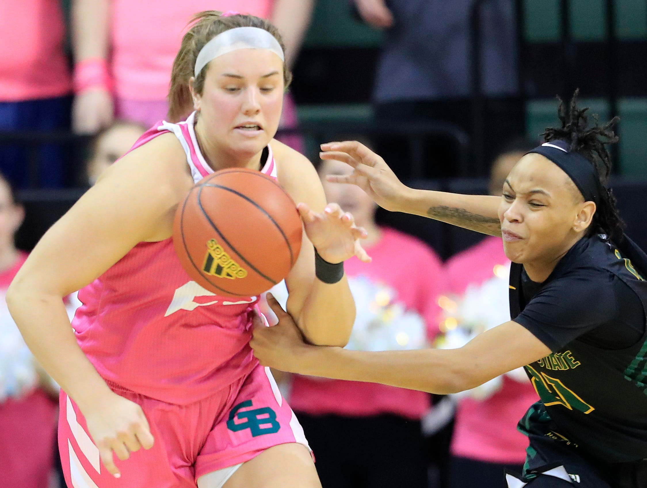Green Bay Phoenix guard/forward Lyndsey Robson (25) comes away with a loose ball against Wright State Raiders forward Dasia Evans (21) in a Horizon League women's basketball game at the Kress Center on Saturday, February 9, 2019 in Green Bay, Wis.