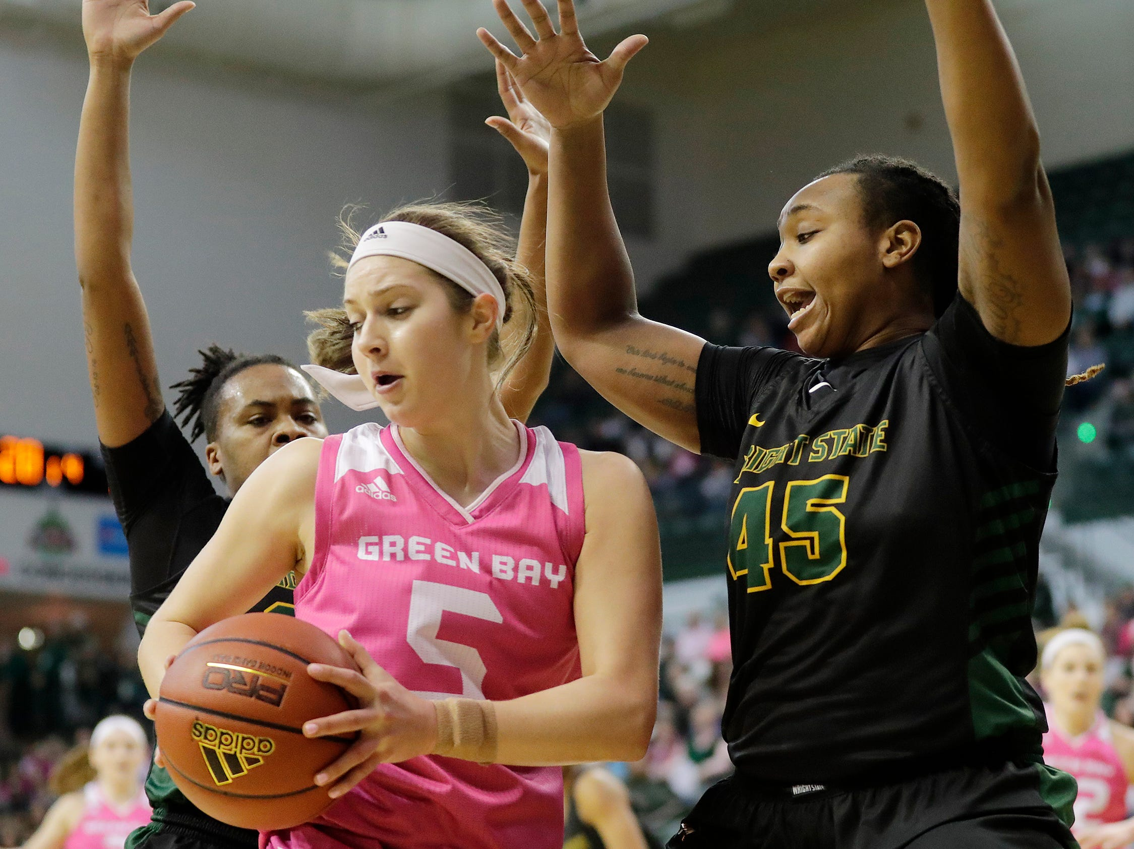 Green Bay Phoenix guard Laken James (5) dribbles out of a trap against Wright State Raiders forward Imani Partlow (45) in a Horizon League women's basketball game at the Kress Center on Saturday, February 9, 2019 in Green Bay, Wis.