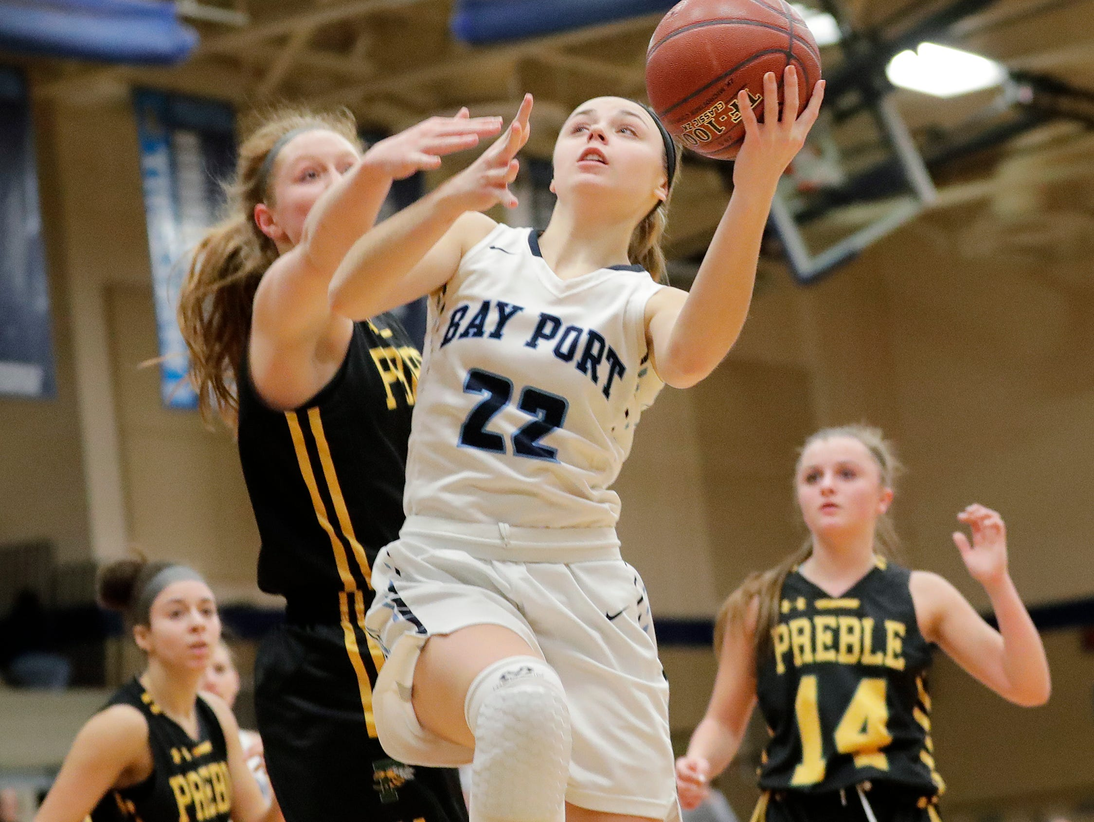 Bay Port's McKenzie Johnson (22) shoots against Green Bay Preble in a FRCC girls basketball game at Bay Port high school on Friday, February 8, 2019 in Suamico, Wis.