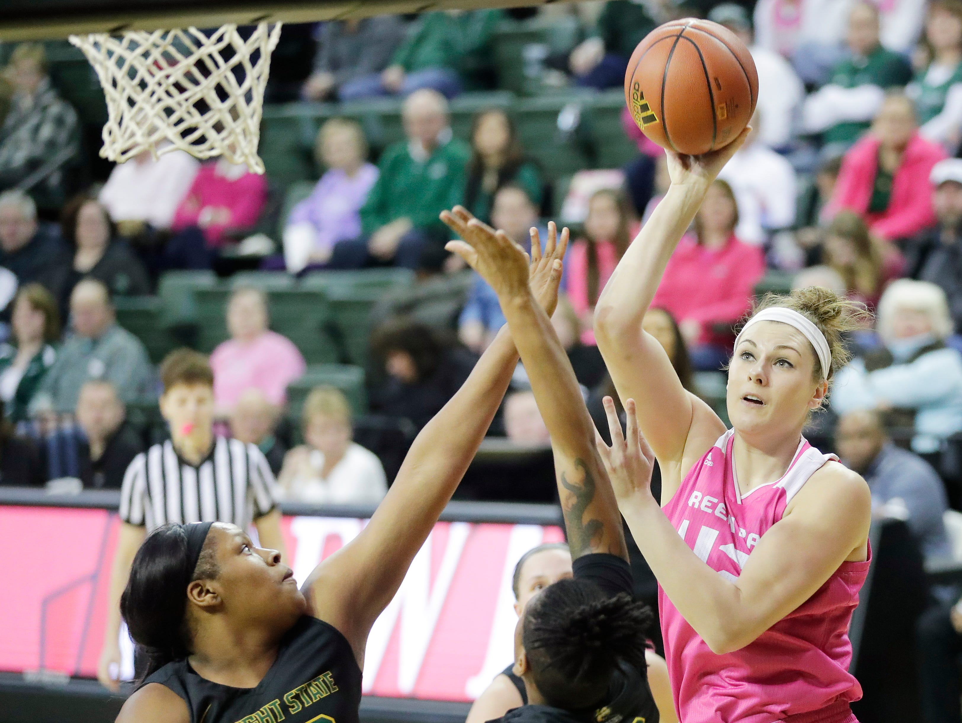 Green Bay Phoenix forward/center Mackenzie Wolf (42) shoots past Wright State Raiders center Tyler Frierson (33) in a Horizon League women's basketball game at the Kress Center on Saturday, February 9, 2019 in Green Bay, Wis.