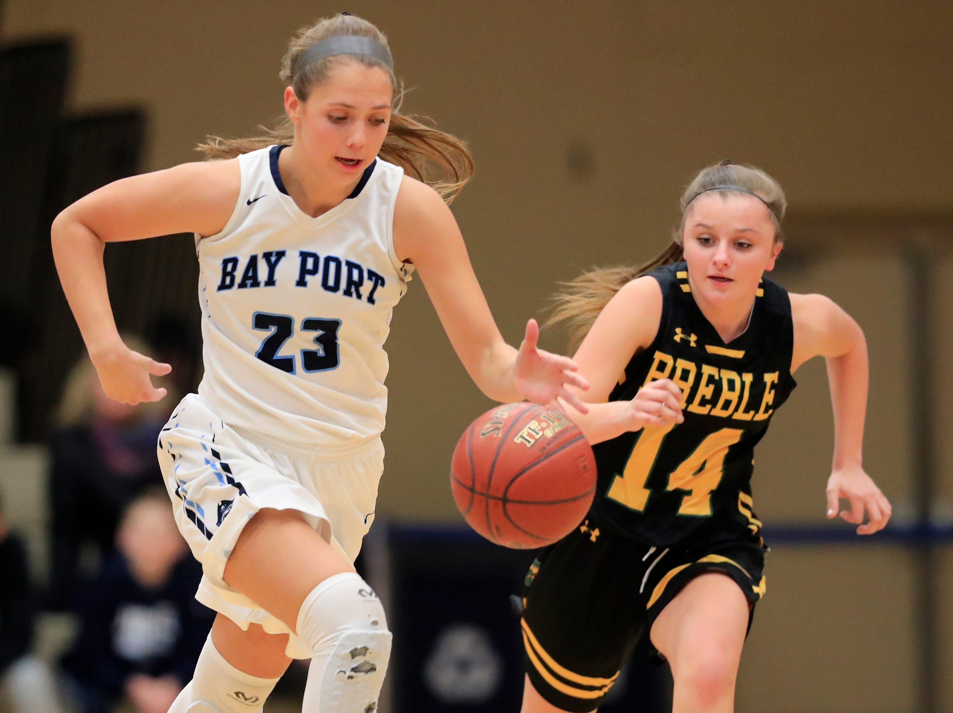 Bay Port's Emma Nagel (23) gets a steal against Green Bay Preble's Taylor Sleger (14) in a FRCC girls basketball game at Bay Port high school on Friday, February 8, 2019 in Suamico, Wis.
