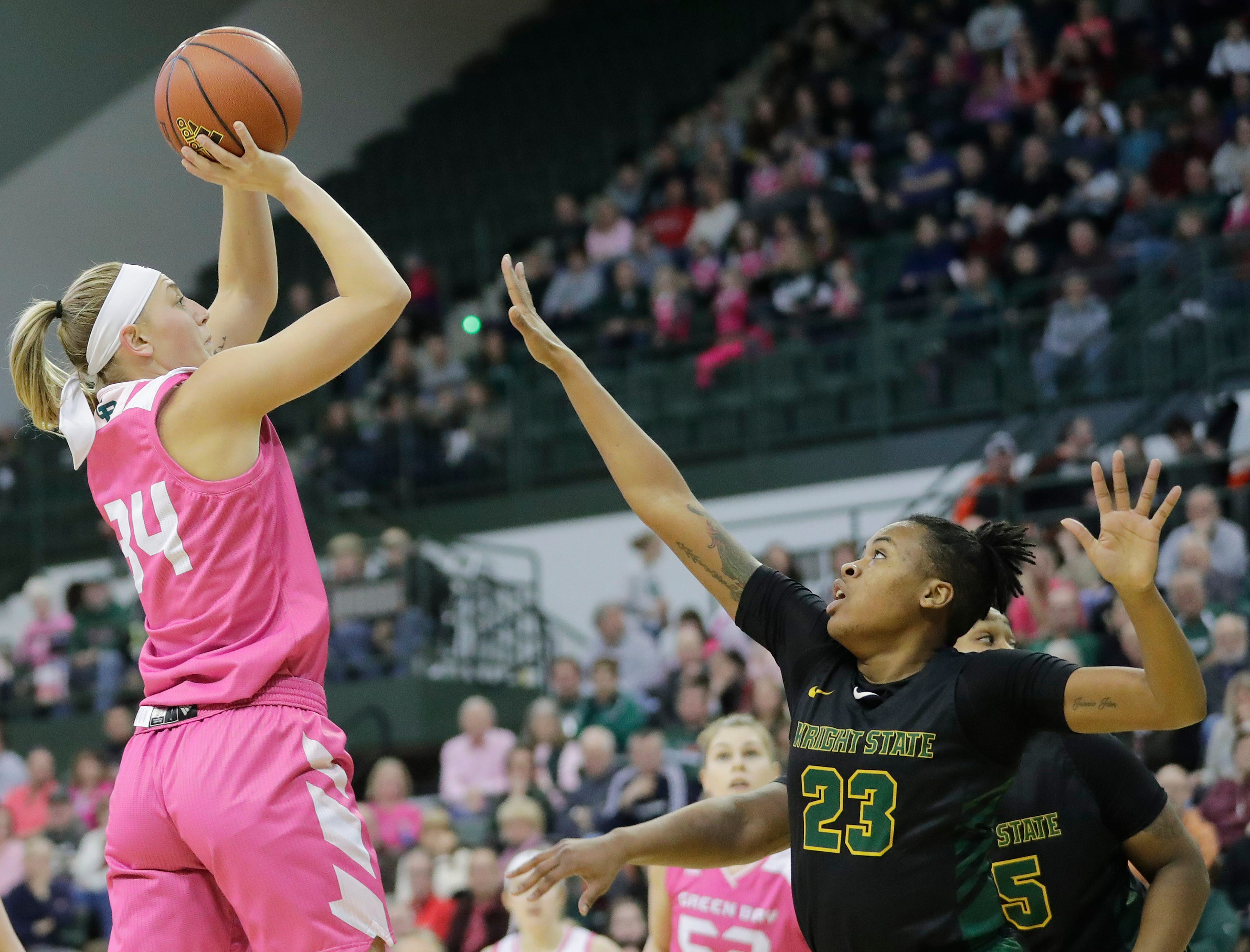 Green Bay Phoenix forward Carly Mohns (34) shoots over Wright State Raiders guard Symone Simmons (23) in a Horizon League women's basketball game at the Kress Center on Saturday, February 9, 2019 in Green Bay, Wis.