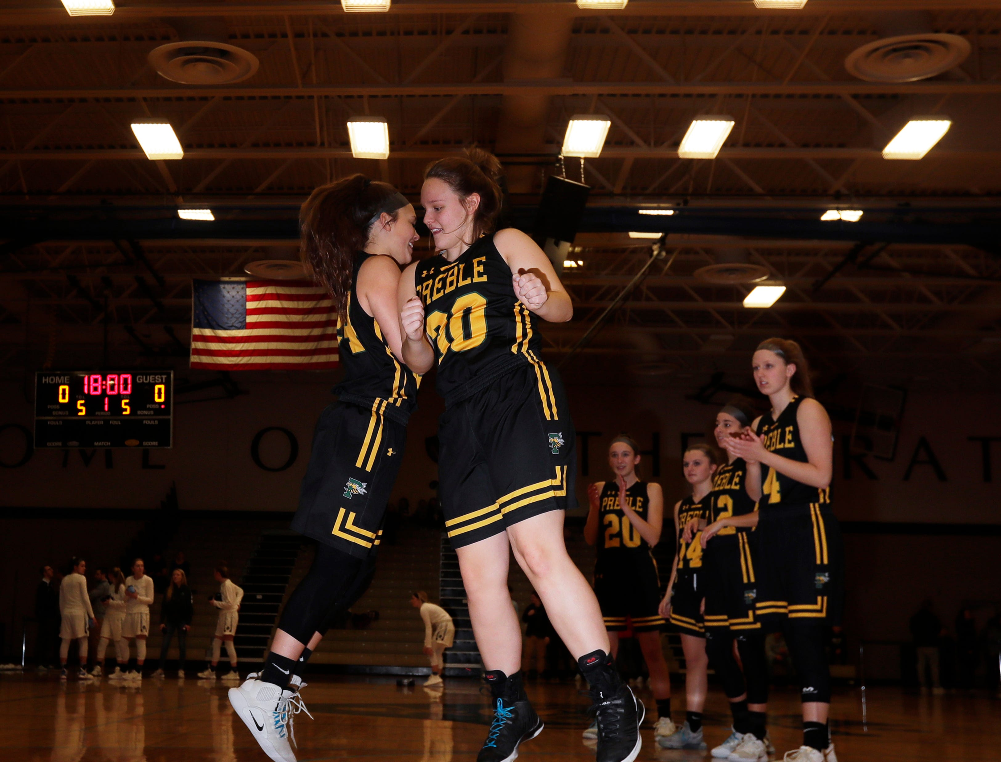Green Bay Preble's team is introduced for a FRCC girls basketball game at Bay Port high school on Friday, February 8, 2019 in Suamico, Wis.