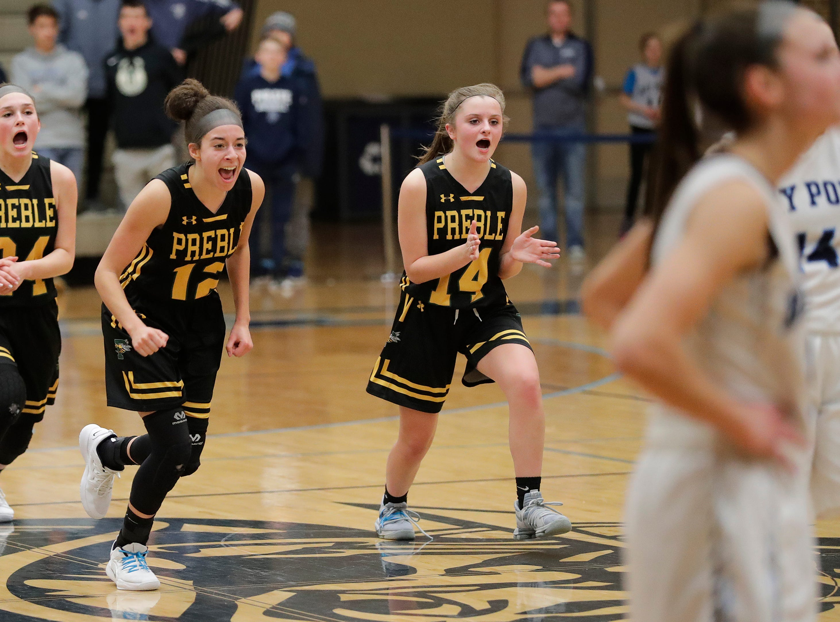 Green Bay Preble players celebrate a made free throw in the final minute against Bay Port in an FRCC girls basketball game at Bay Port high school on Friday, February 8, 2019 in Suamico, Wis.