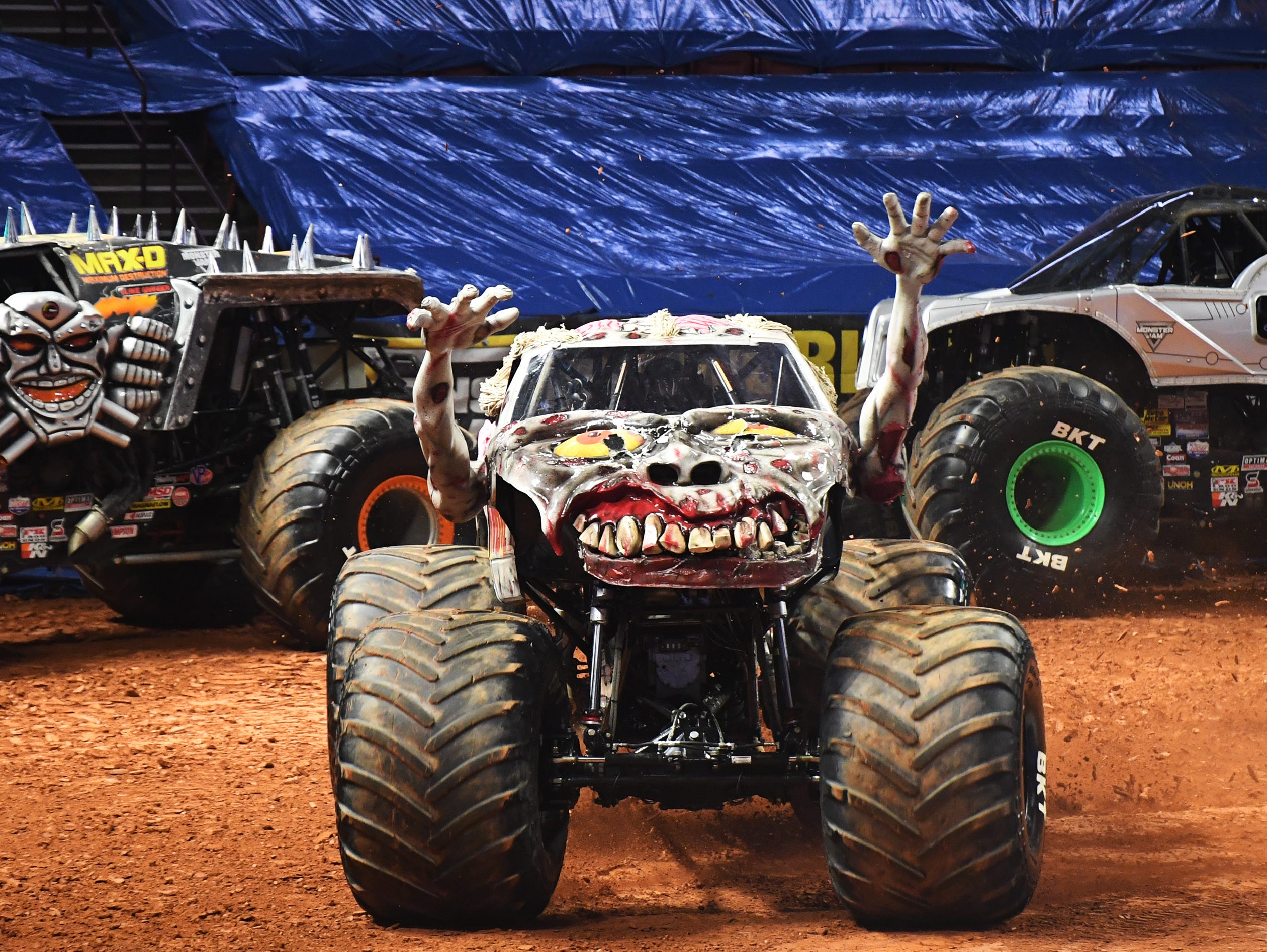 A driver competes in Zombie during the Monster Jam Racing competition at Bon Secours Wellness Arena Friday, Feb. 8, 2019.